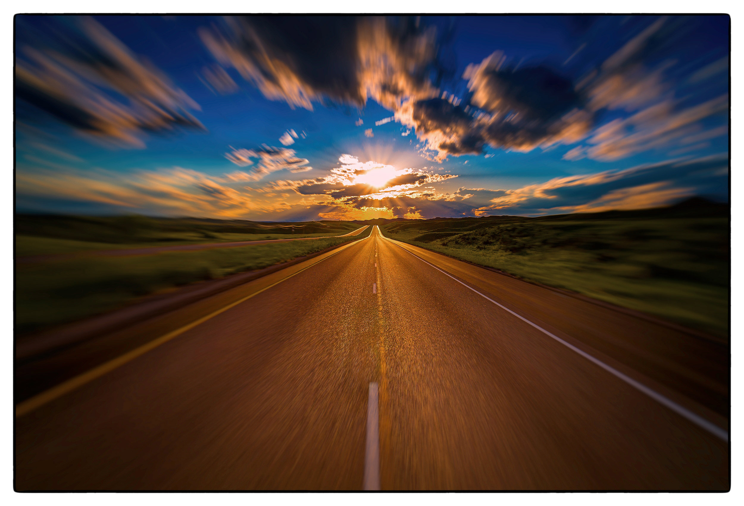 a-brilliant-sun-sets-over-the-i90-highway-in-wyoming-usa