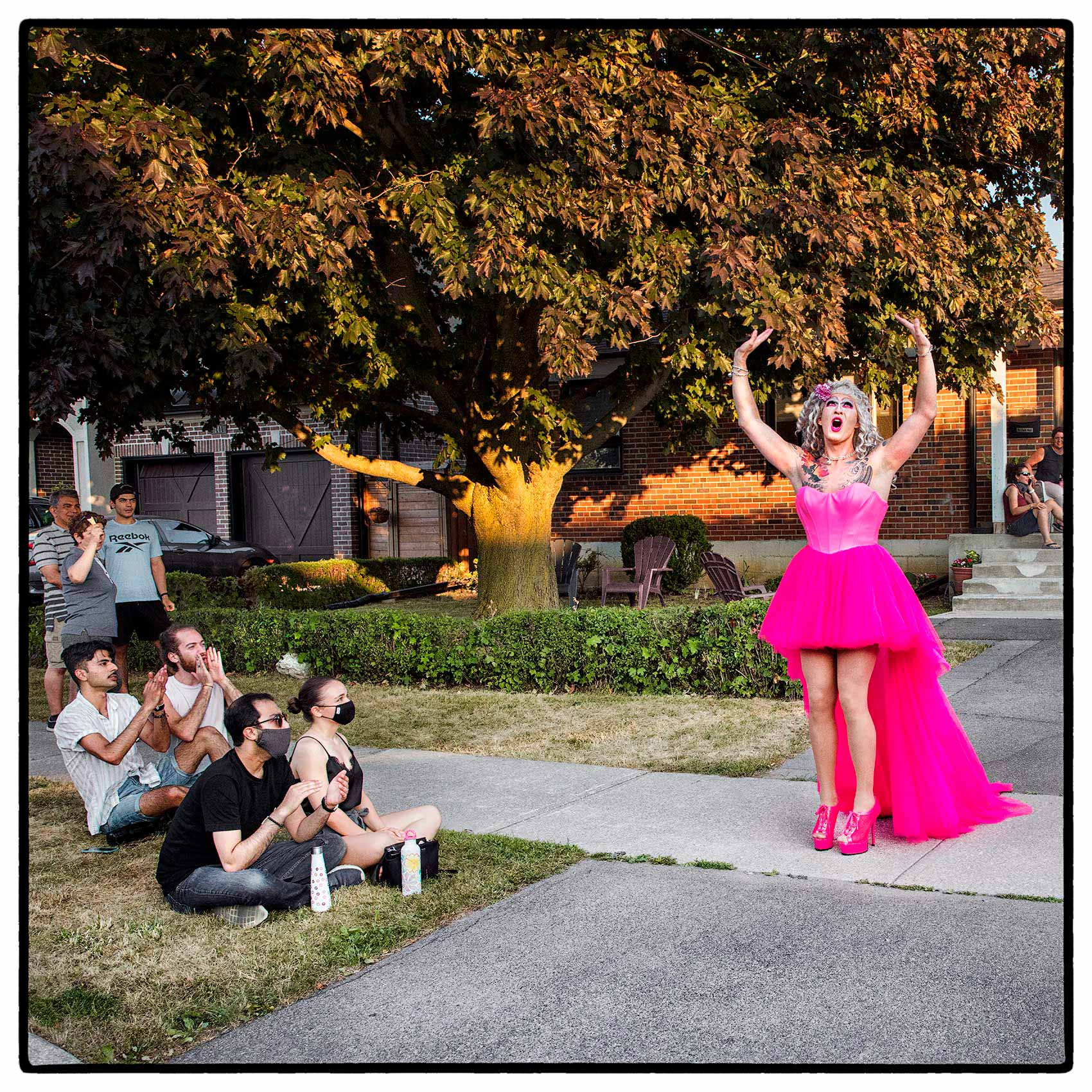 A drag queen performing outside for her neighbors in north york