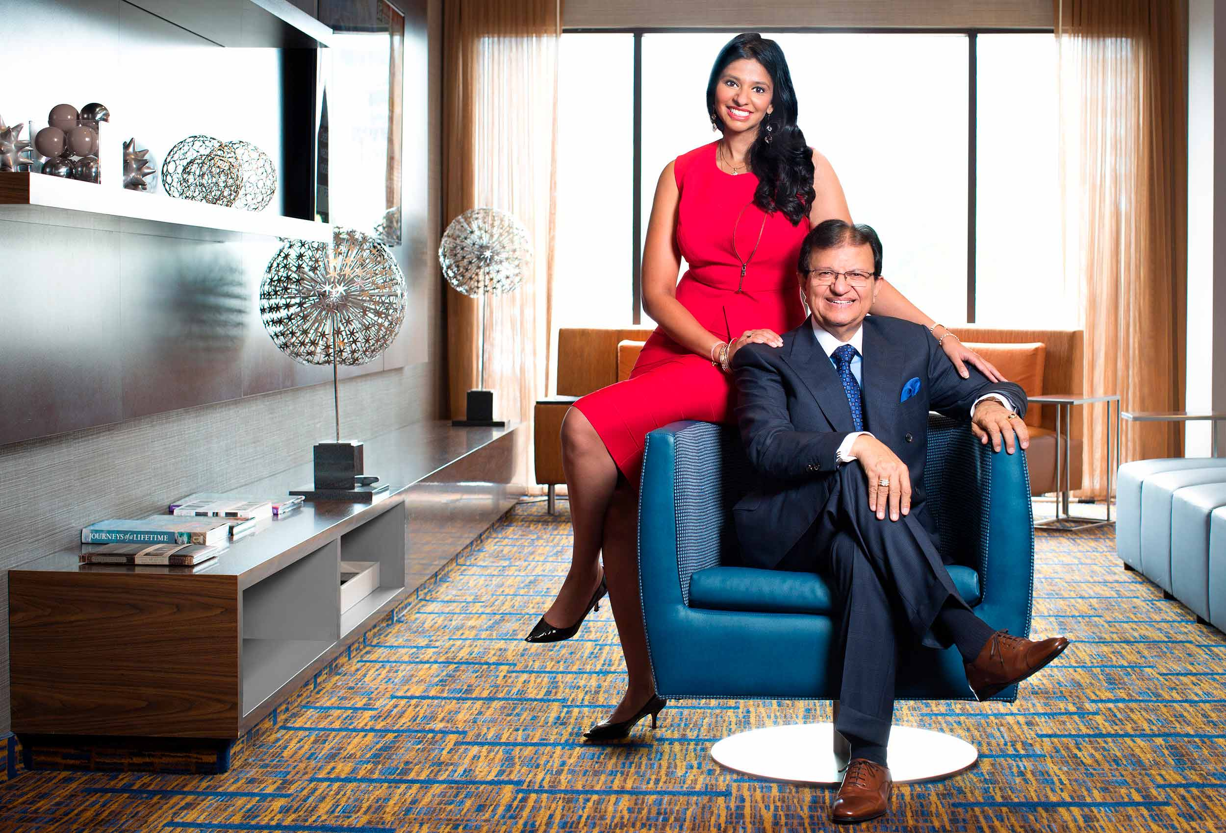steve and reetu gupta pose for a photo at one of their toronto hotels