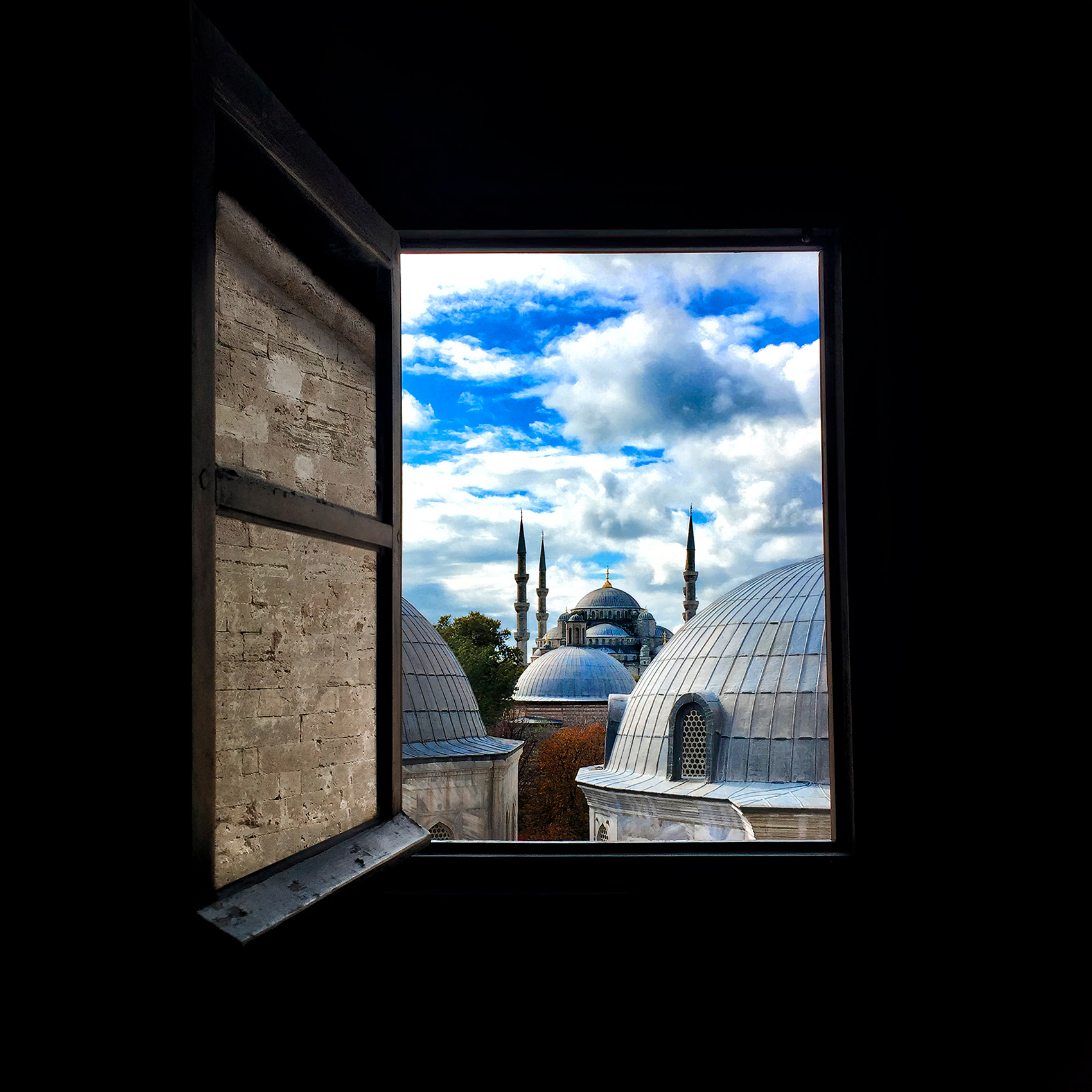 a beautiful view of the blue mosque from a window inside the hagia sofia mosque window in istanbul turkey.