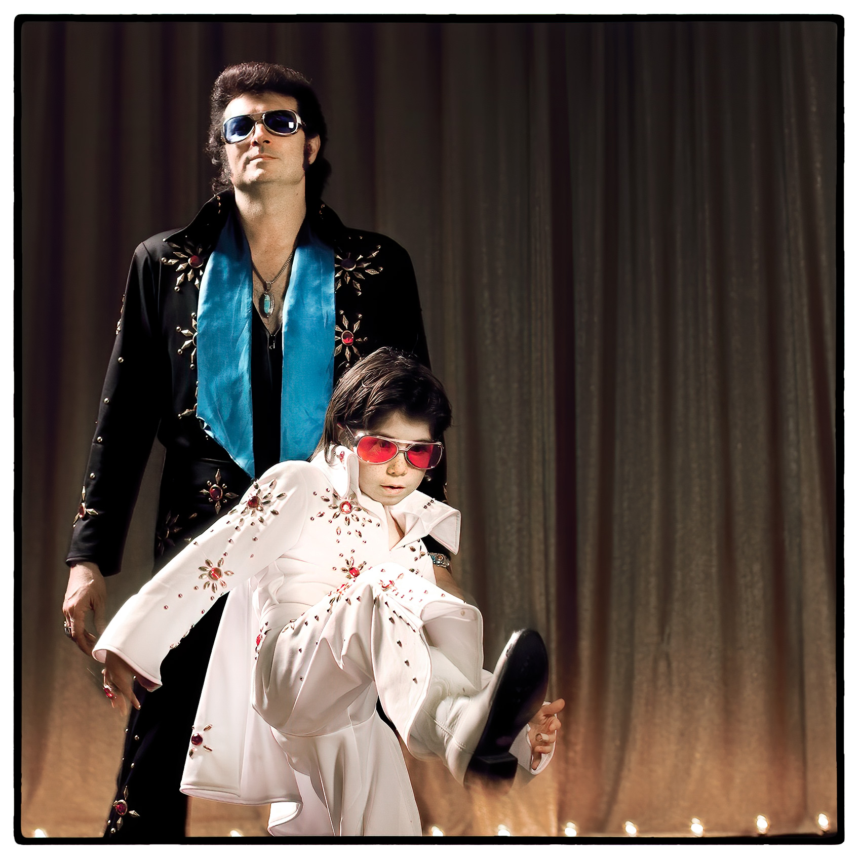 a-boy-and-a-man-who-are-elvis-impersonators-in-las-vegas