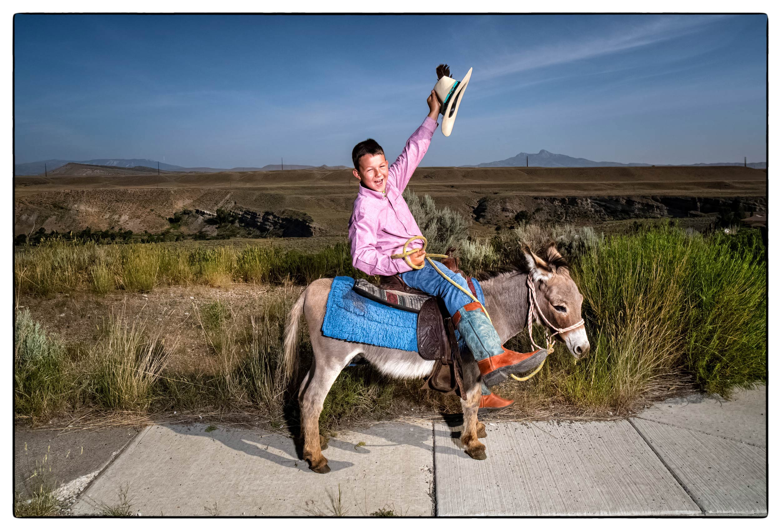 a-boy-celebrates-the-fourth-of-july-by-riding-a-donkey-in-the-parade-in-cody-wyoming