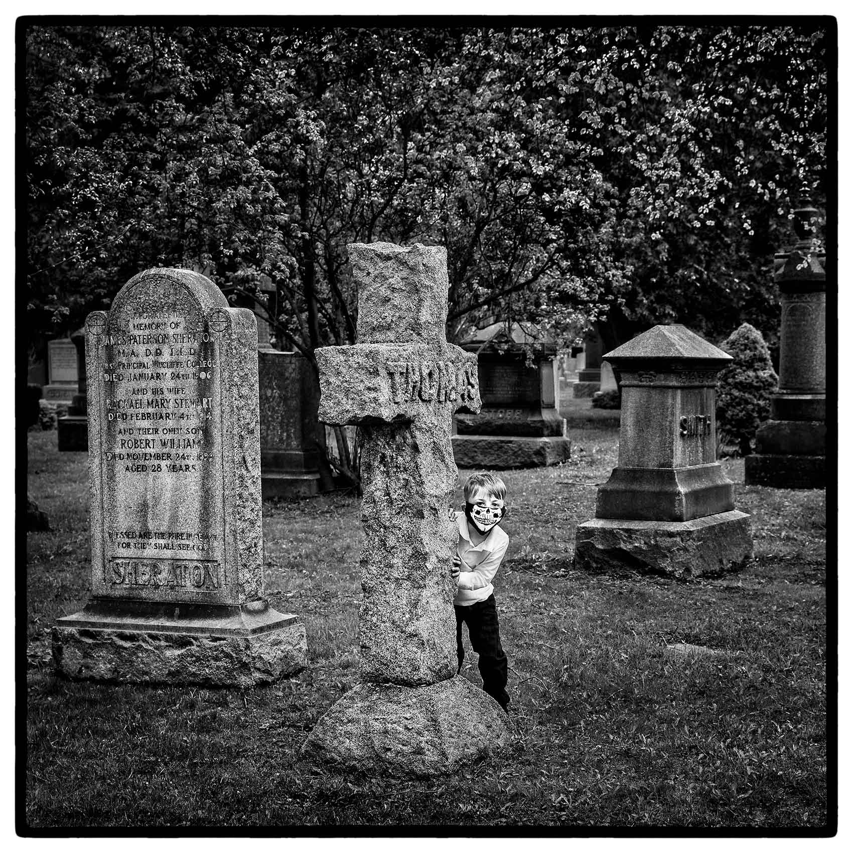 a-boy-in-skull-and-bones-mask-in-a-toronto-cemetery-by-award-winning-toronto-photographer