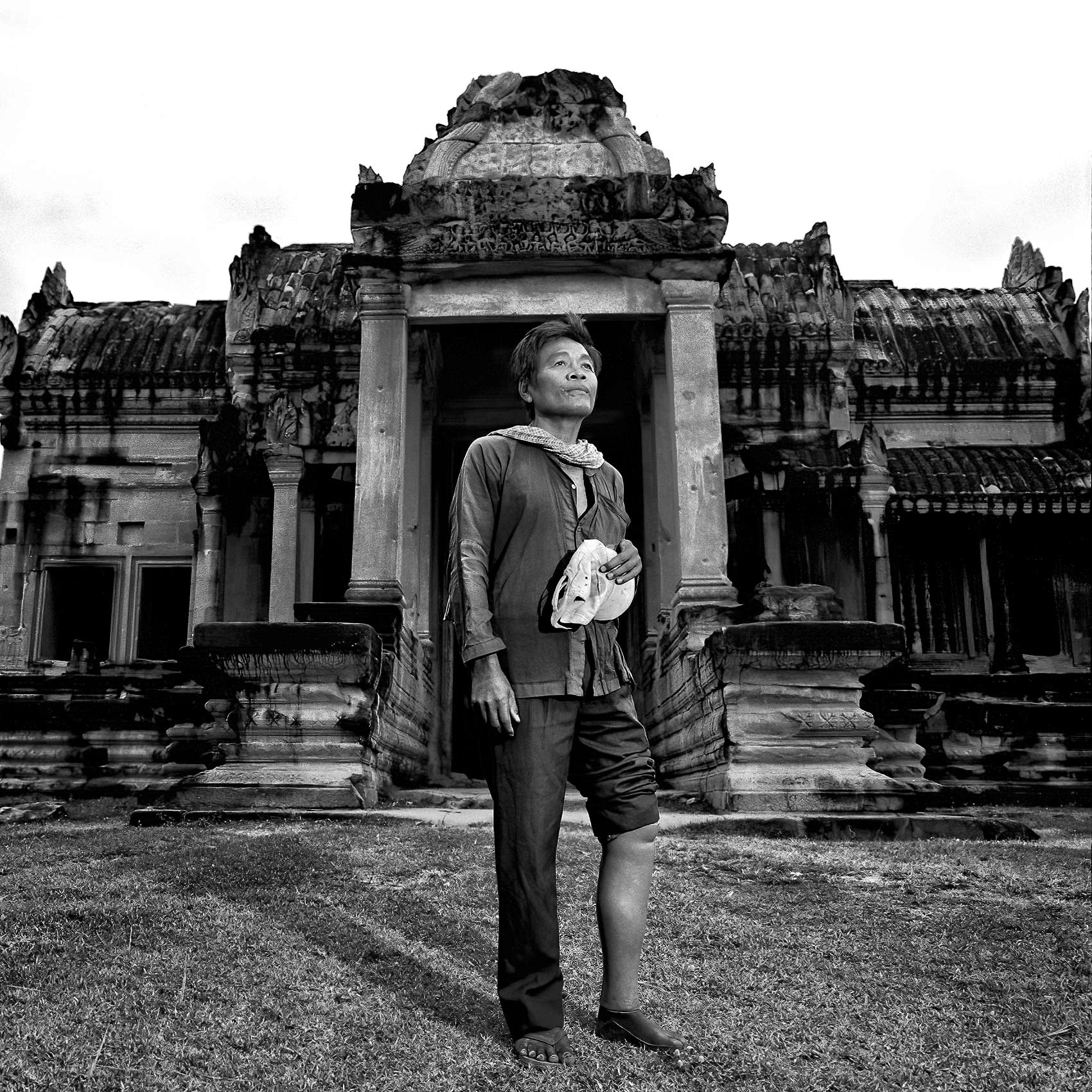 a-cambodian-man-who-was-a-victim-of-a-landmine-poses-for-a-photo-at-angkor-wat