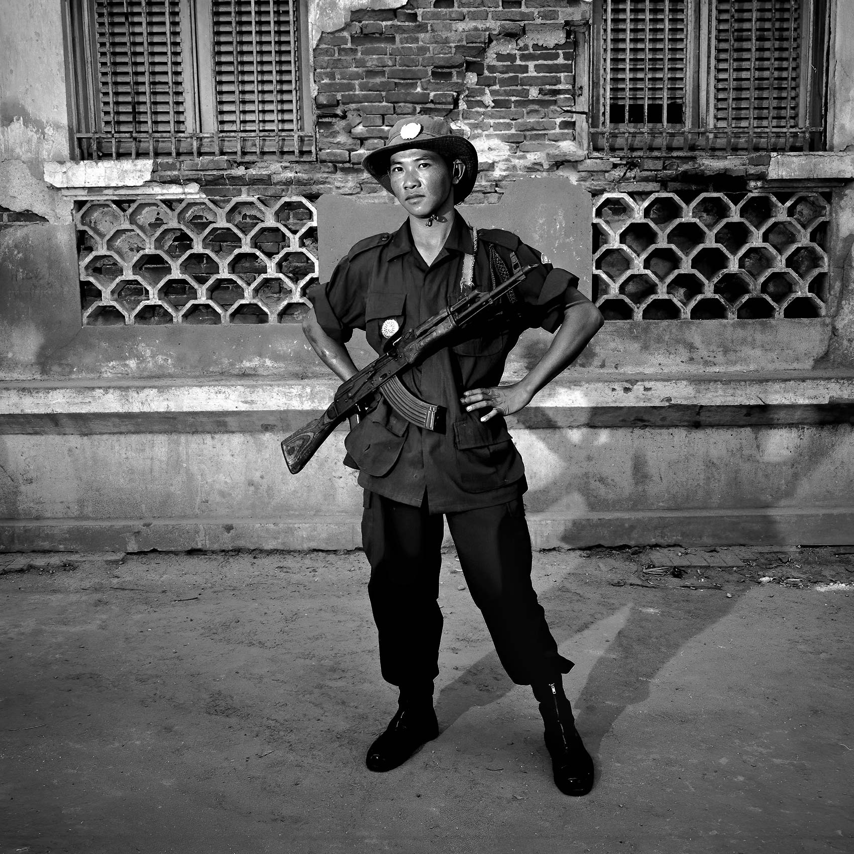 a-cambodian-solider-poses-for-a-photo-with-an-ak-47-in-phnom-penh