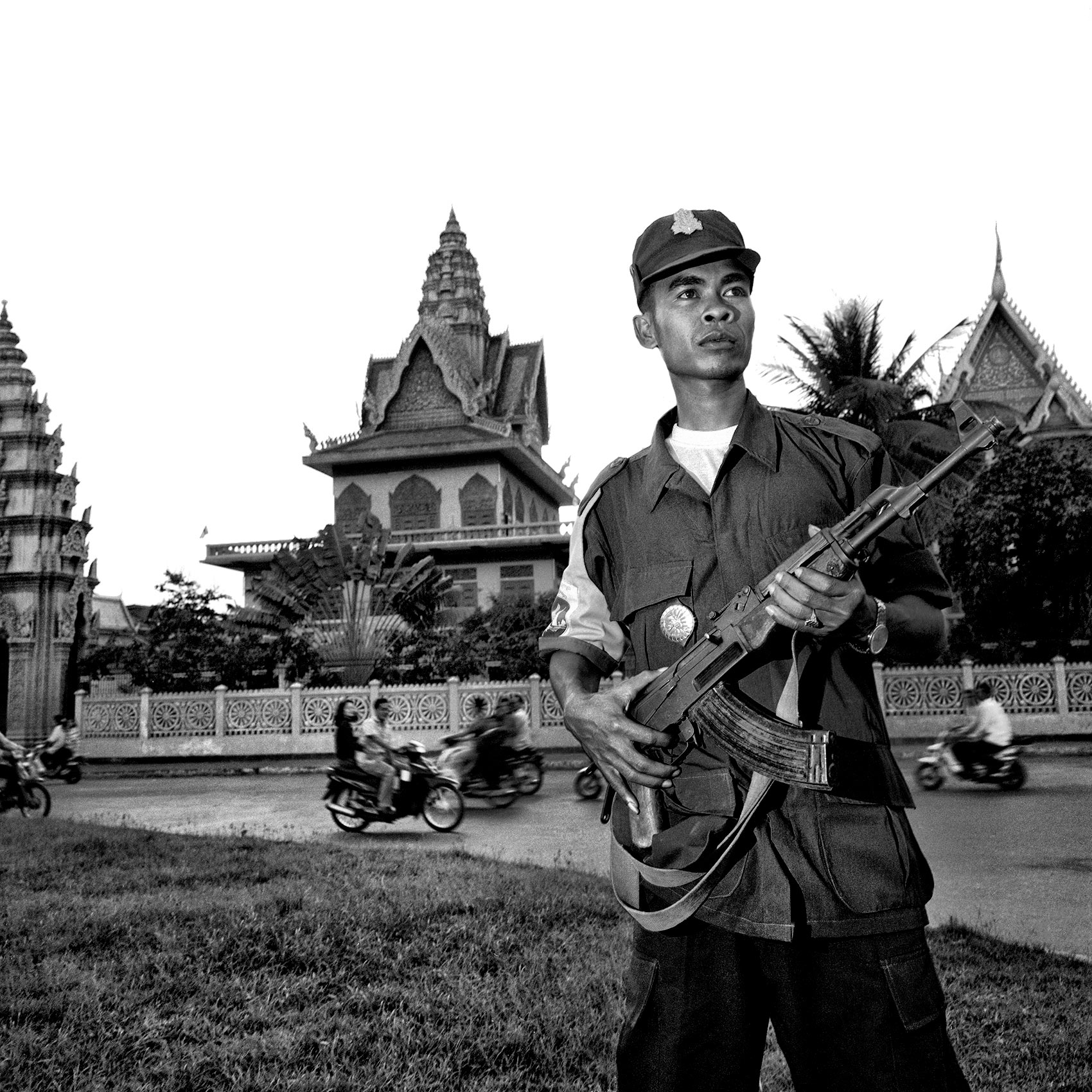 a-cambodian-soldier-holds-his-ak-47-as-patrols-the-streets-of-phnom-pehn-cambodia