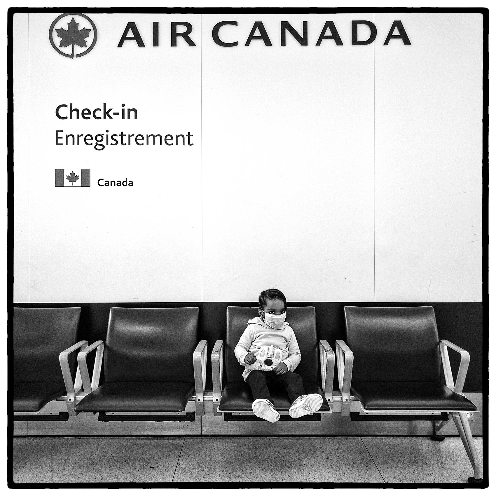 a-child-waits-for-her-flight-during-the-pandemic-at-toronto-pearson-by-john-hryniuk