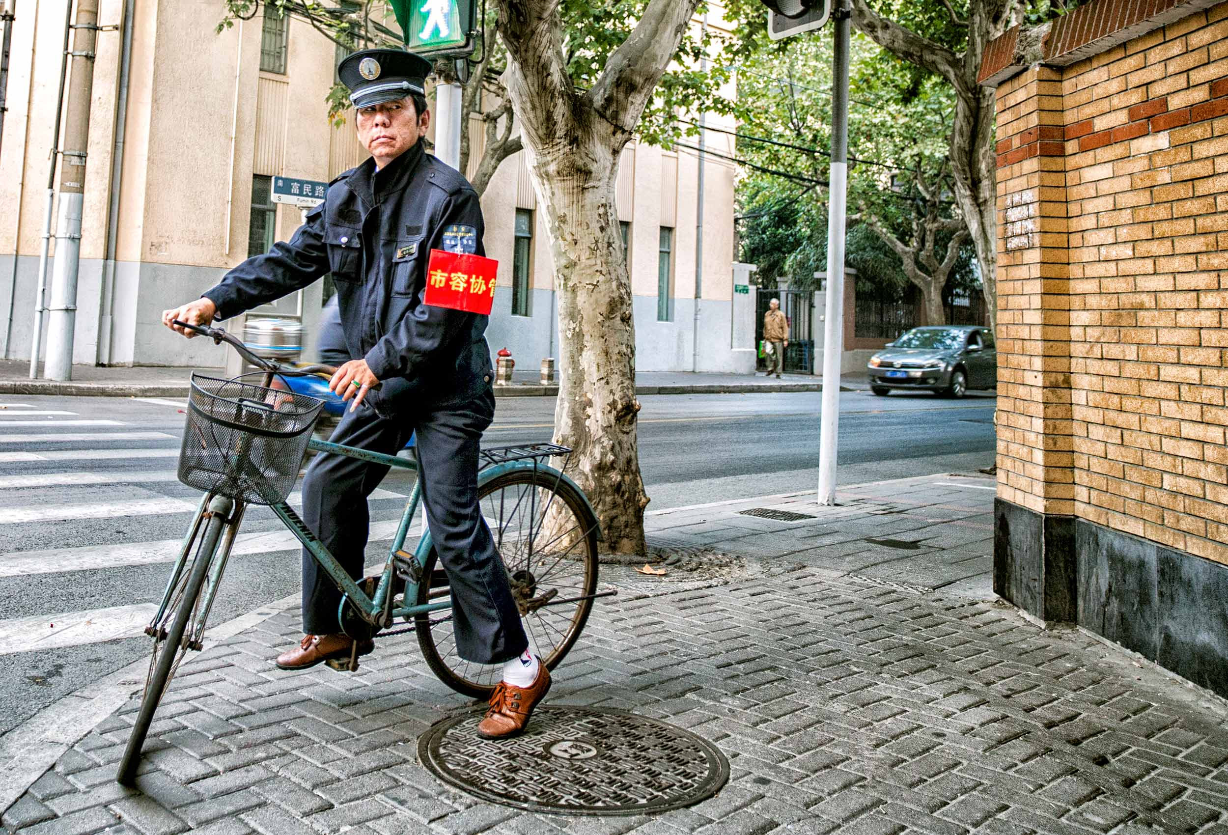 a-chinese-police-patrols-beijing-on-his-bicycle-in-the-city