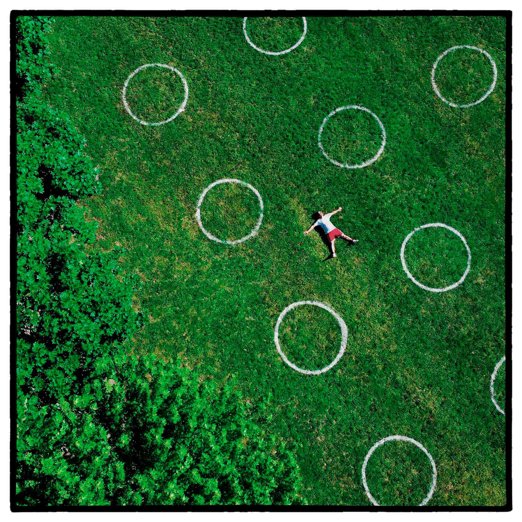 an-aerial-photo-of-a-man-inside-social-distancing-circles-at-trinity-bellwoods-park