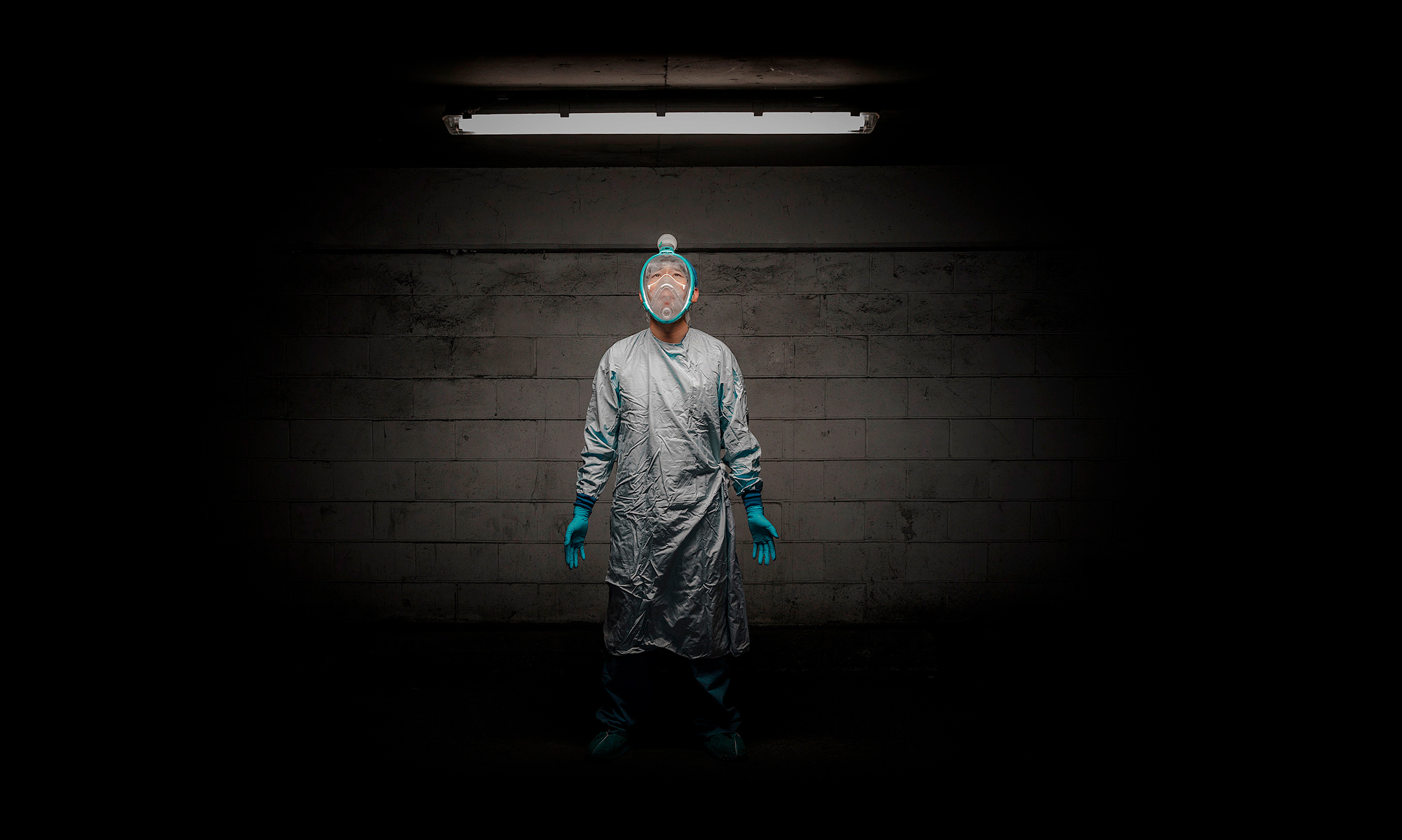 a portrait of a doctor wearing personal protective equipment during the pandemic in toronto