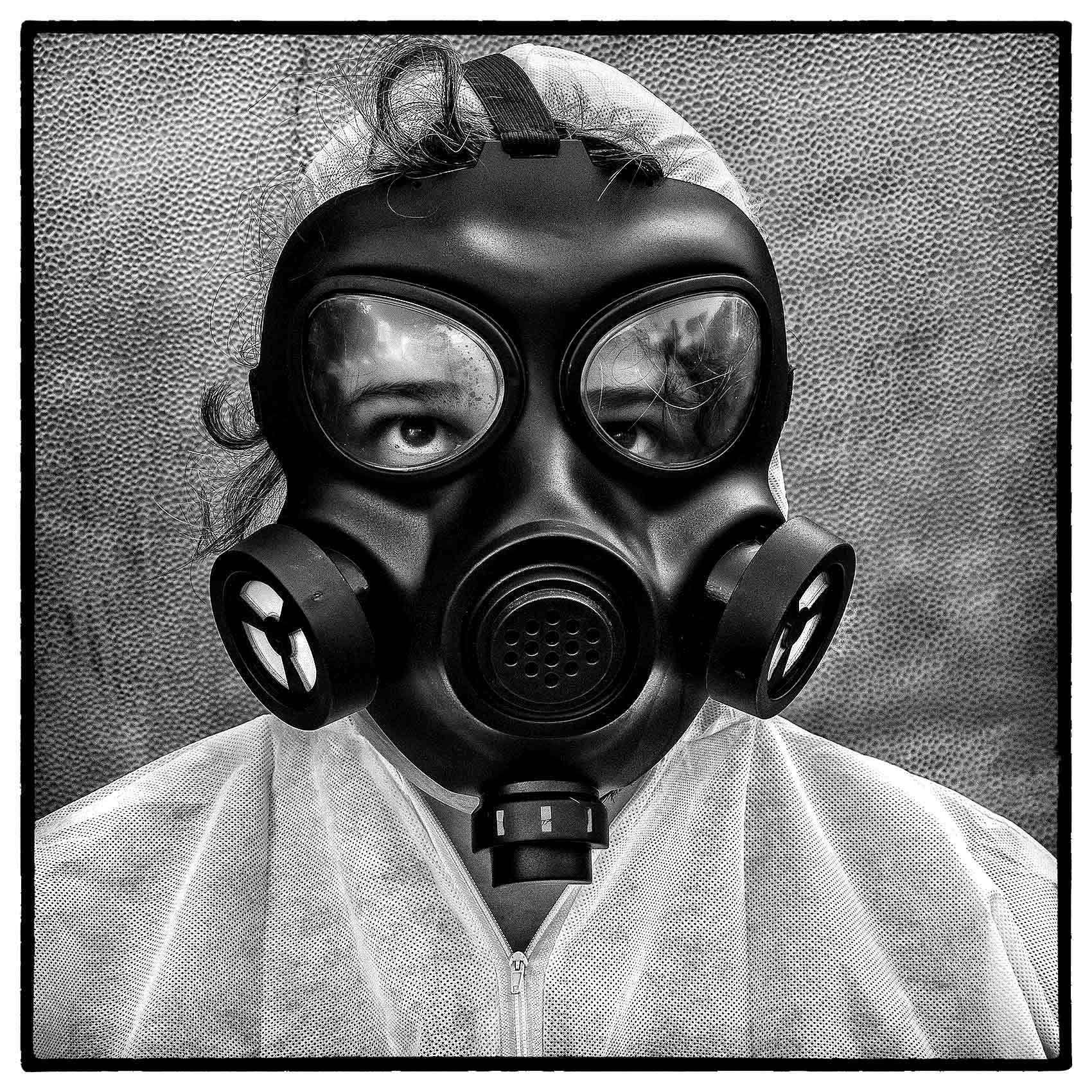a woman sweats as she wears a gas mask in Toronto during the covid-19 pandemic