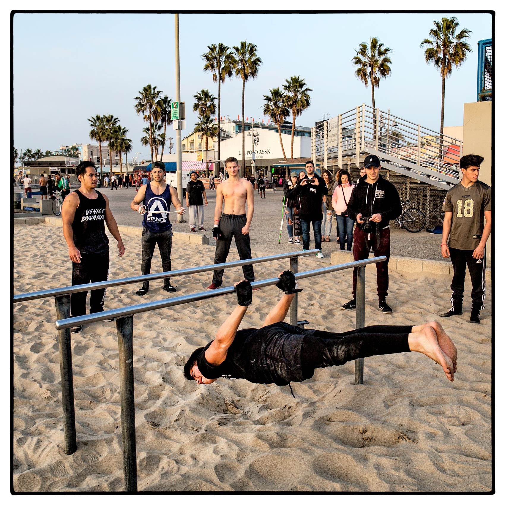 a-group-of-boys-practice-their-gymnastics-on-venice-beach-california-2