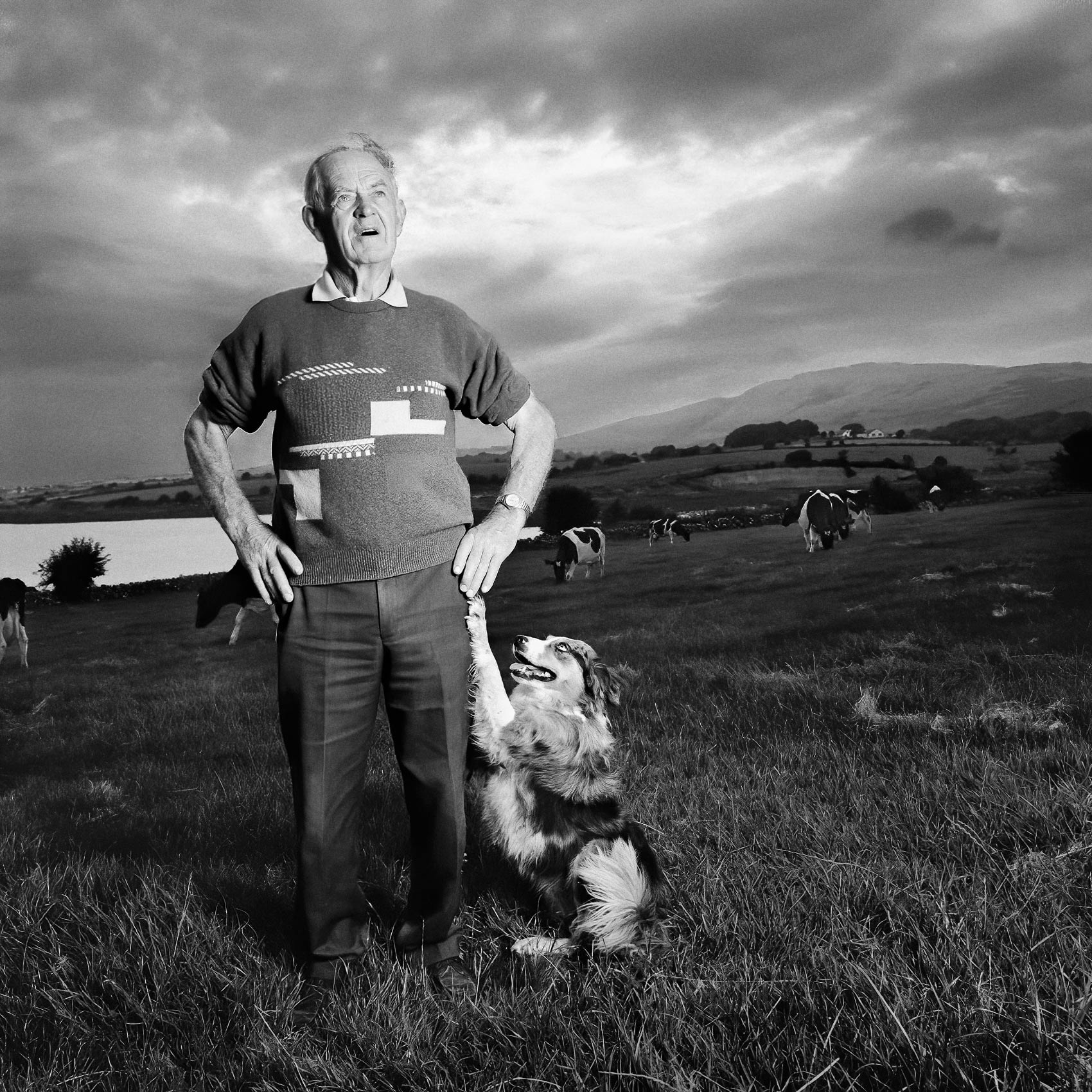 a-irish-farmer-poses-for-a-photo-with-his-trusted-sheep-dog-by-his-side-at-their-farm-outside-of-cork-ireland