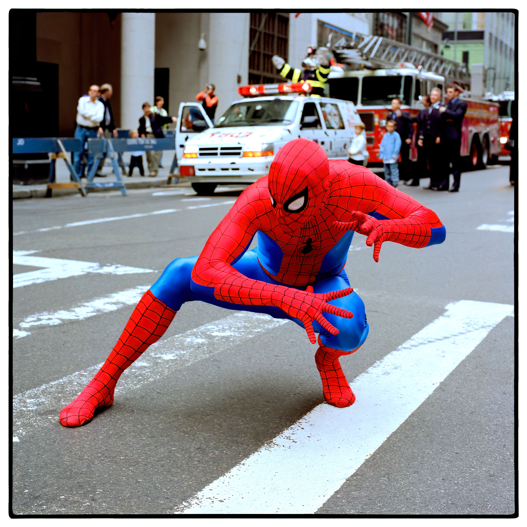a-man-dressed-a-spiderman-poses-for-a-photo-on-the-streets-of-new-york-city