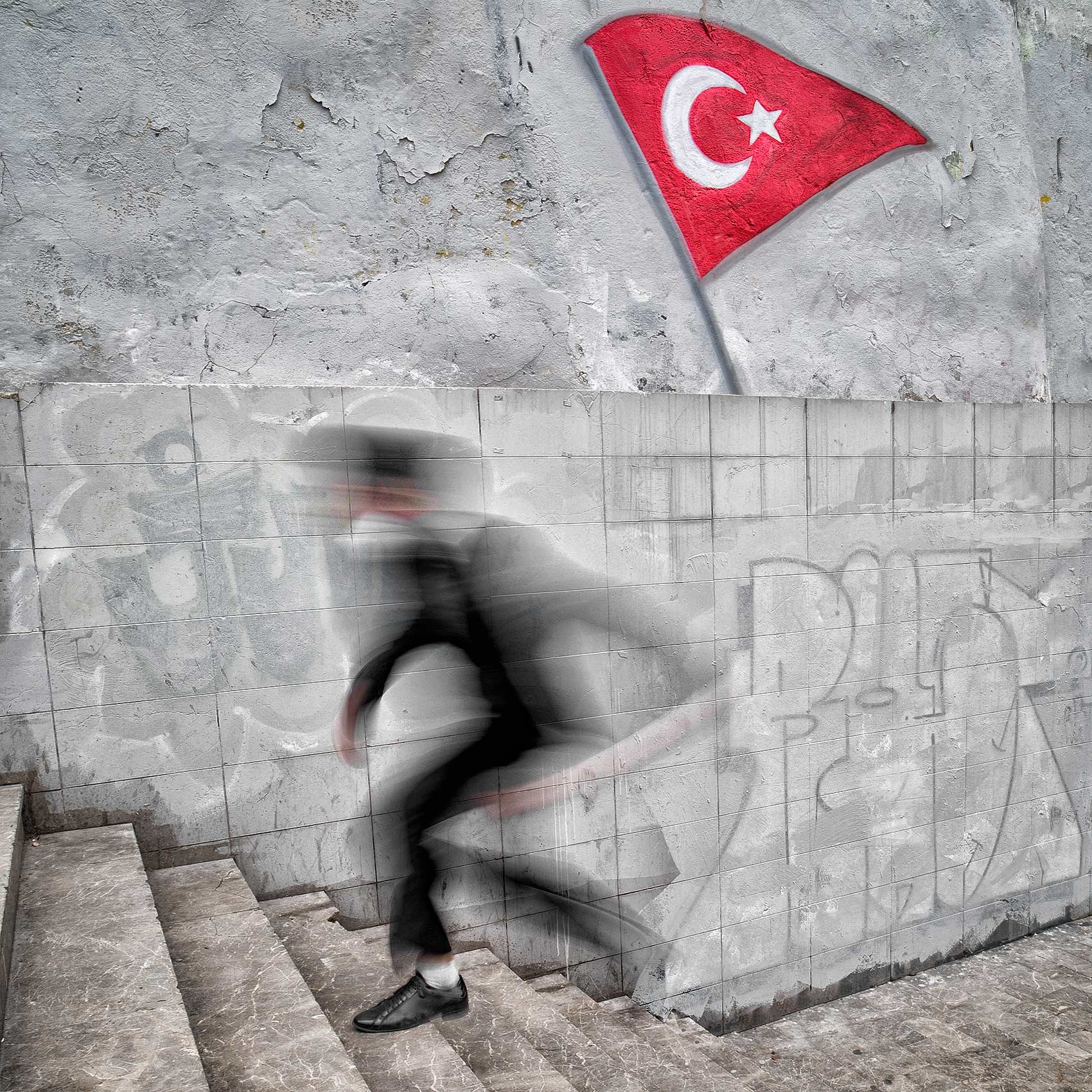 a-man-is-blurred-as-he-runs-up-the-steps-from-an-istanbul-subway