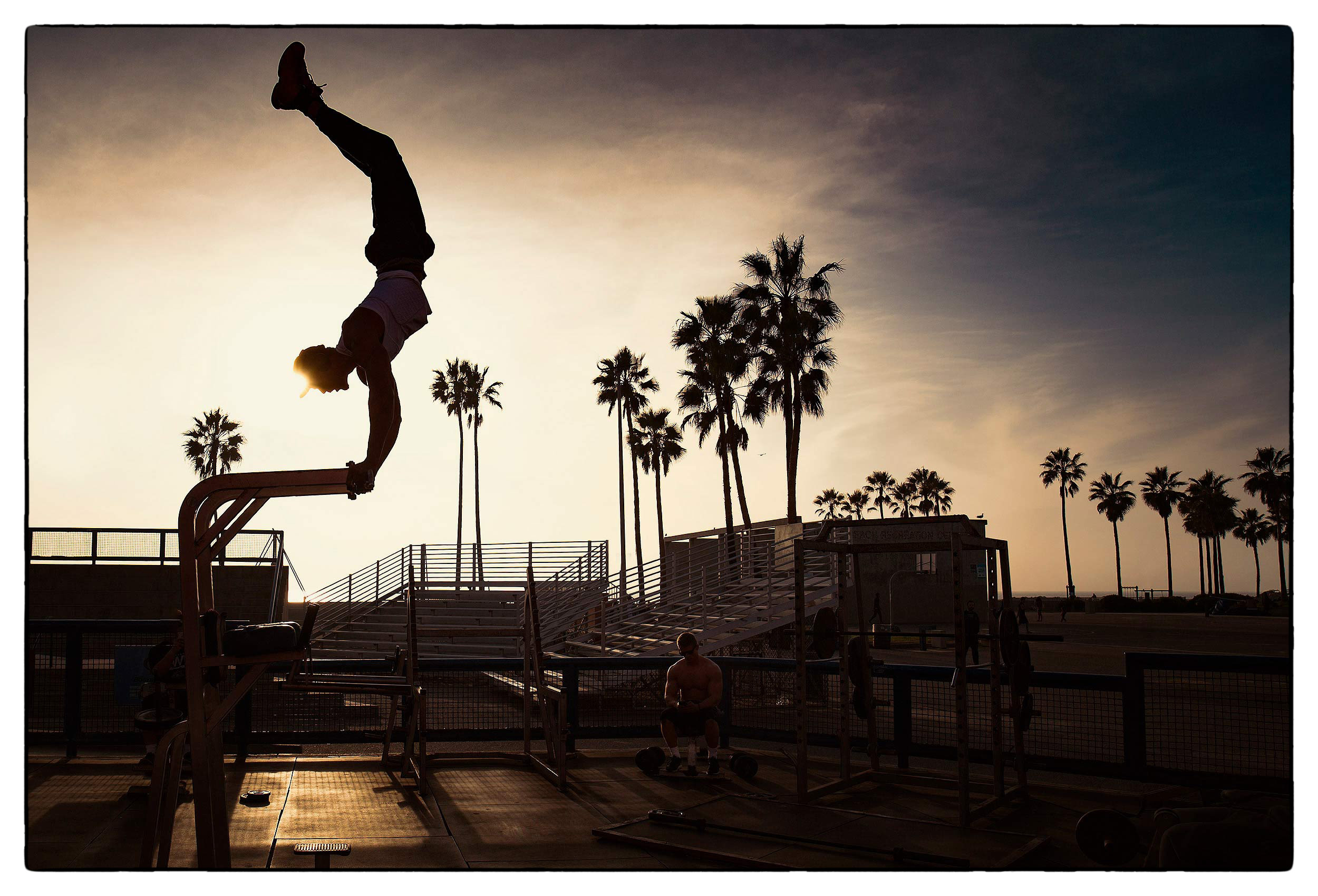 a-man-is-sillhouetted-as-he-works-out-at-venice-californias-muscle-beach2