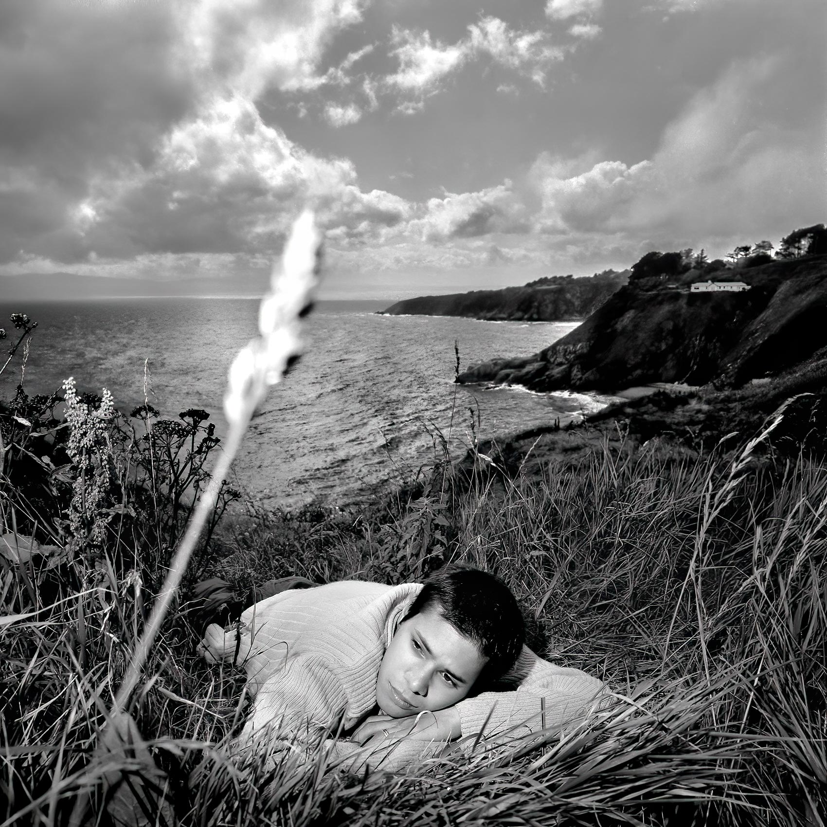 ebehard-schonleays-from-berlin-lays-on-a-hillside-near-the-light-house-in-howth-ireland-with-the-bay-of-dublin-behind-him
