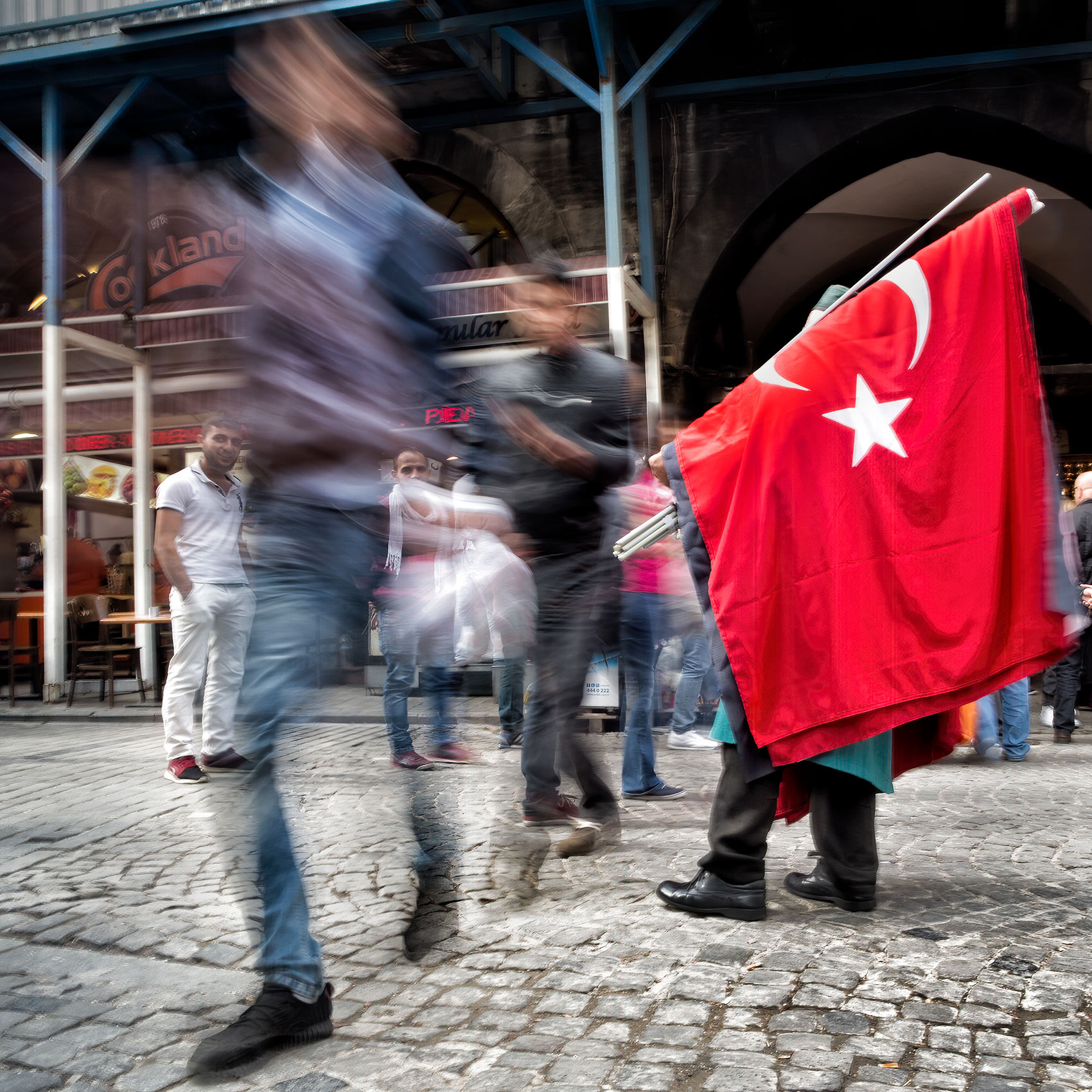 a-man-sells-turkish-flags-outside-istanbuls-spice-market