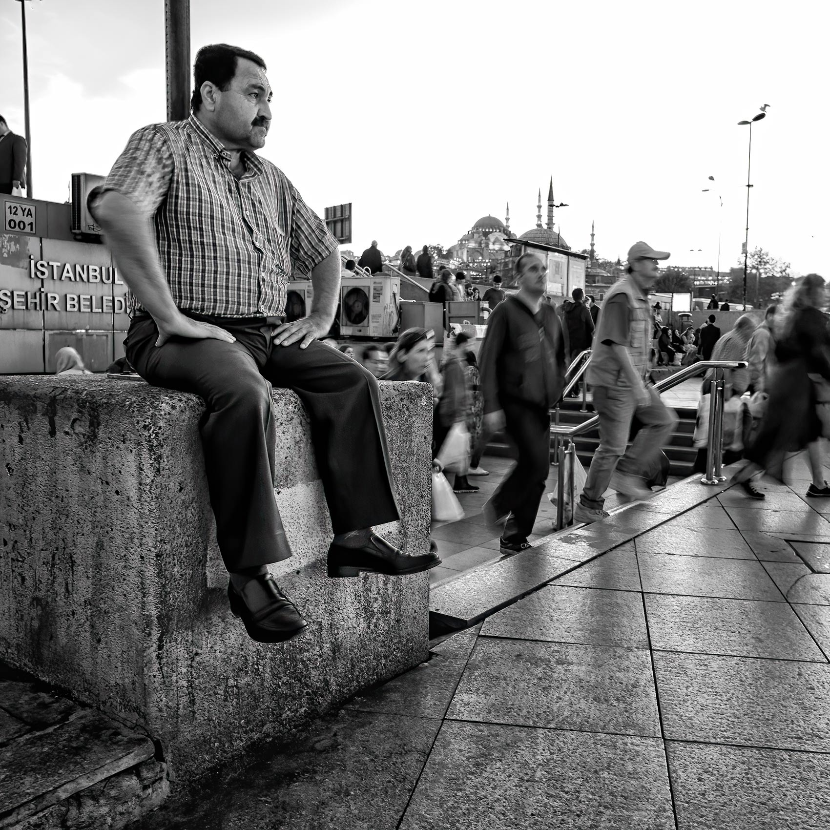a-man-watches-over-the-harbour-in-the-eminonu-district-in-istanbul-turkey