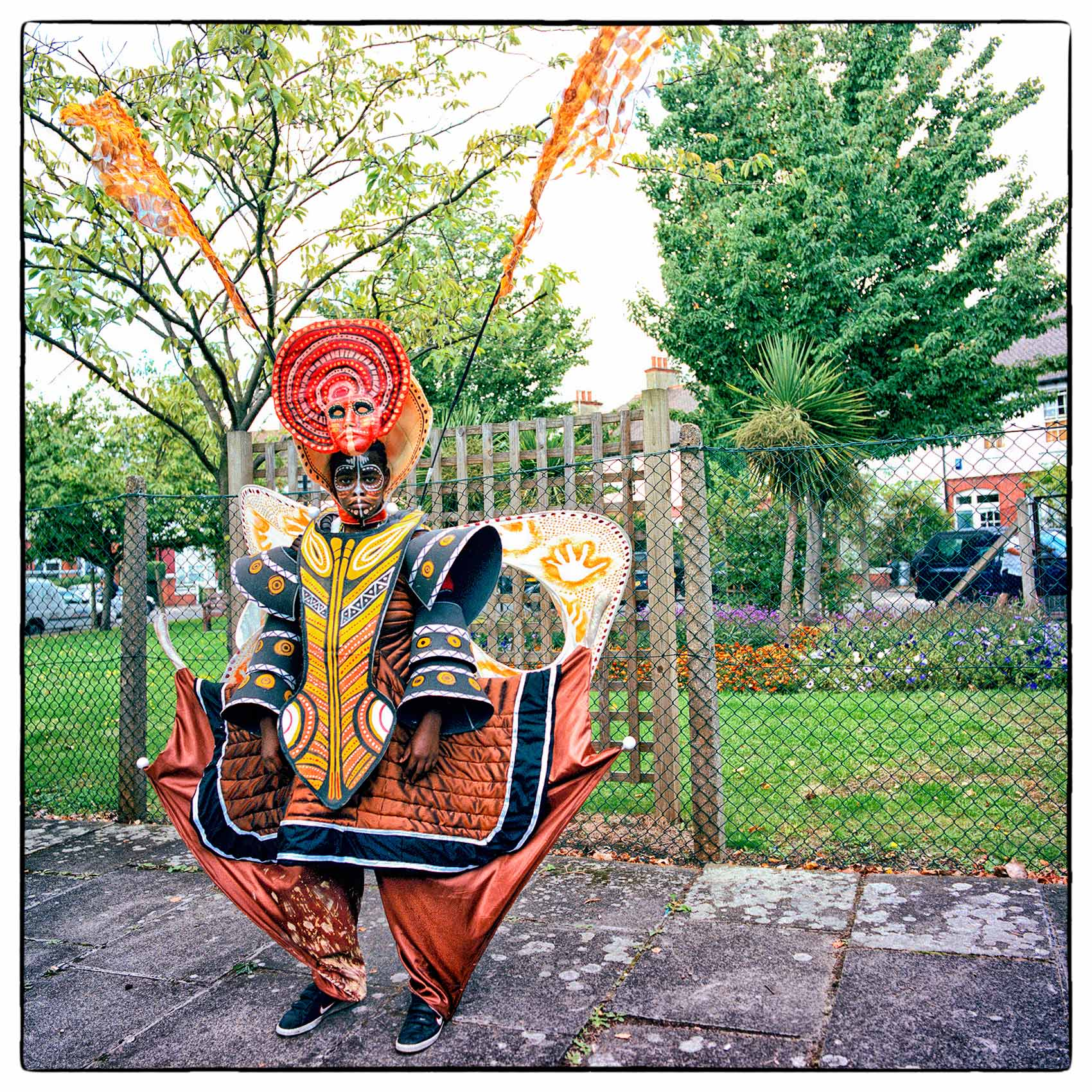 a-man-wearing-a-costume-poses-for-a-photo-in-londons-notting-hill-during-carnival