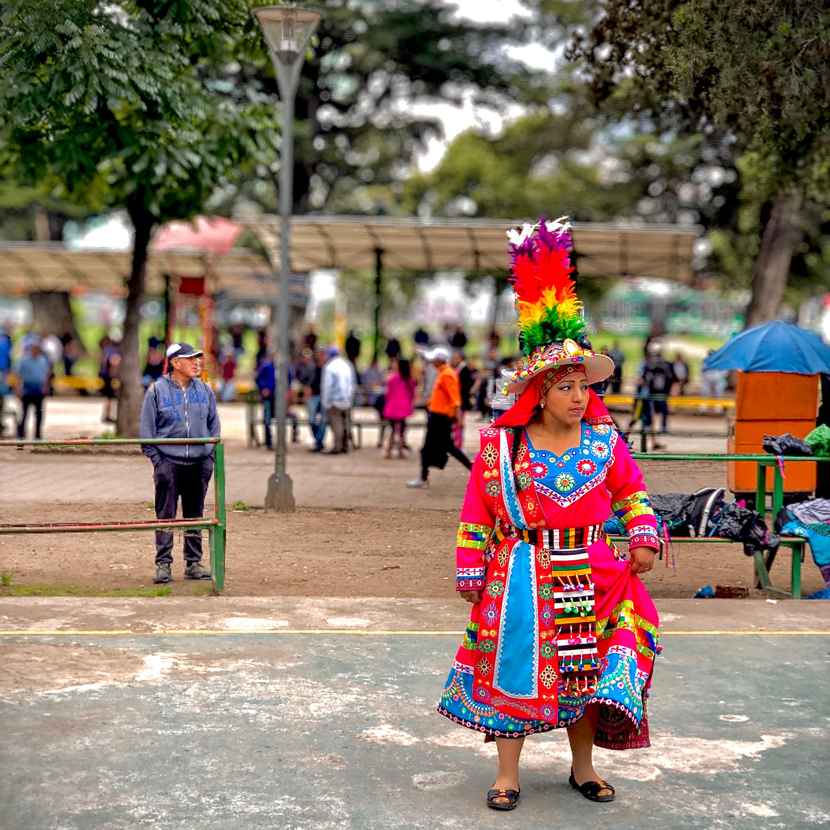 a-mayan-woman-in-traditional-dress-in-a-park-in-quito-ecuador