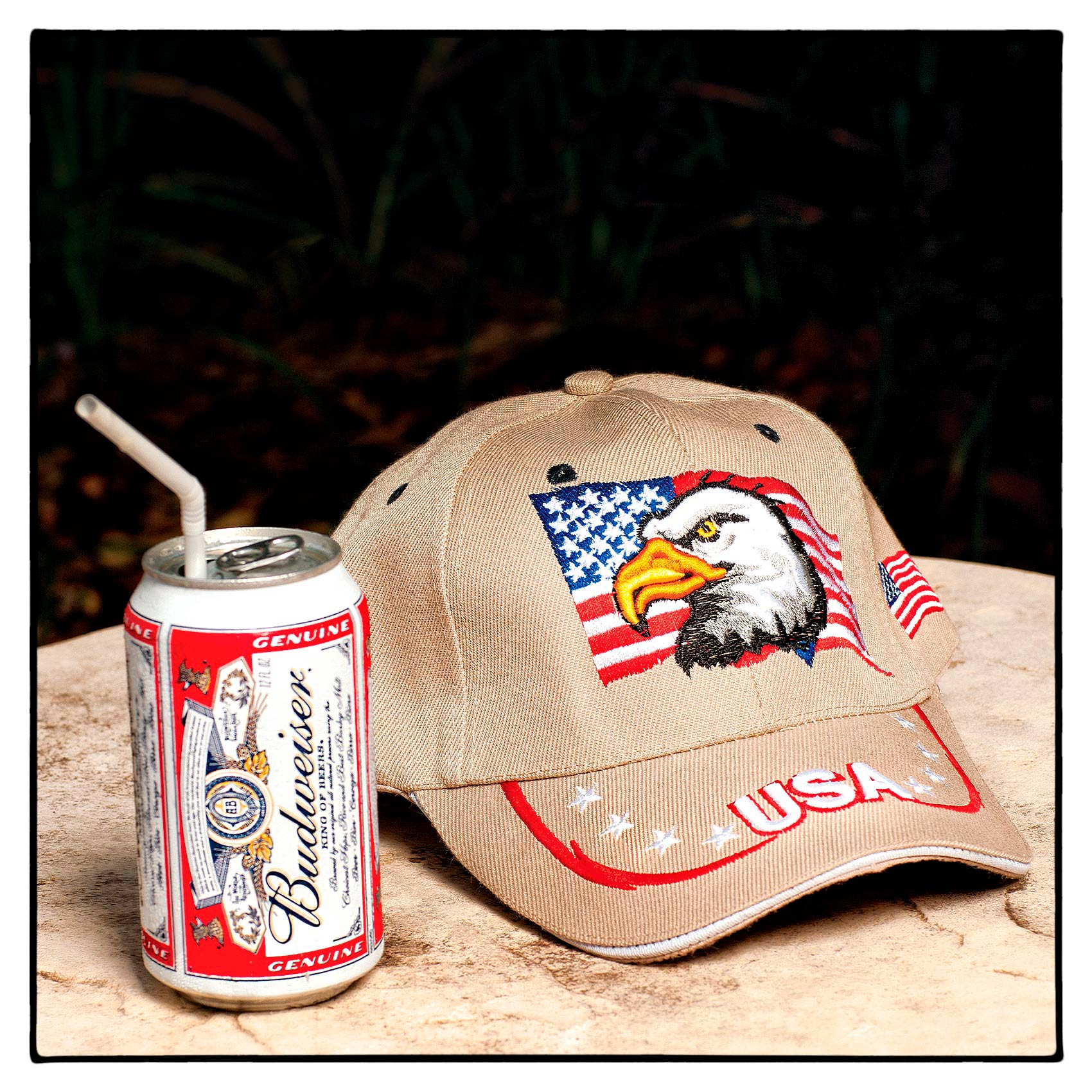 a-budweiser-beer-can-and-a-ball-cap-with-a-us-flag-and-eagle-sit-on-a-hotel-table-in-florida