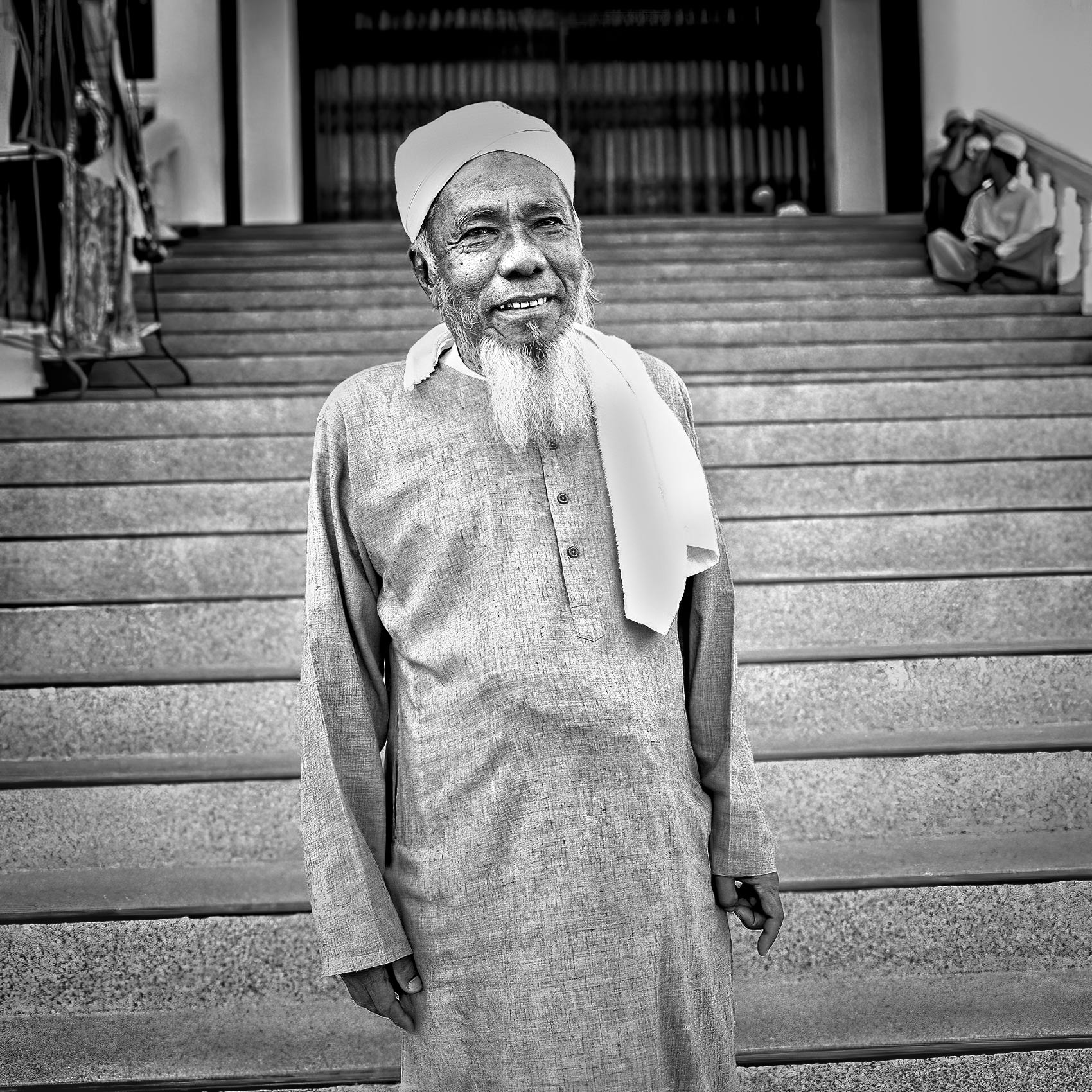 a-muslim-man-who-is-a-rohingya-minority-in-myanmar-poses-for-a-photo-outside-a-mosque-in-rakhine-state