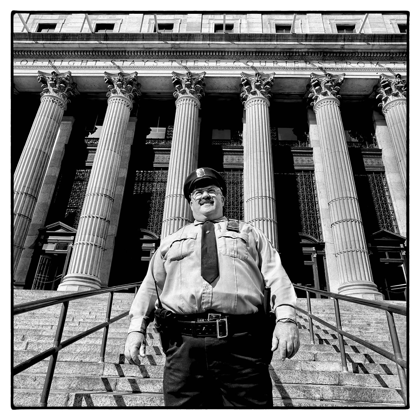 a-nypd-officer-poses-for-a-photo-in-front-of-the-new-york-post-office-in-manhattan
