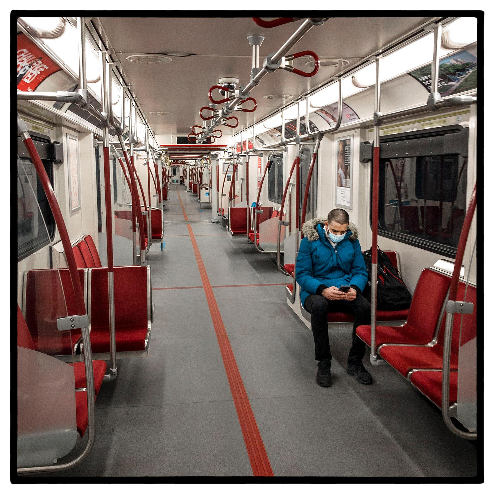 a-passenger-sitting-on-an-empty-subway-car-during-the-pandemic-in-toronto