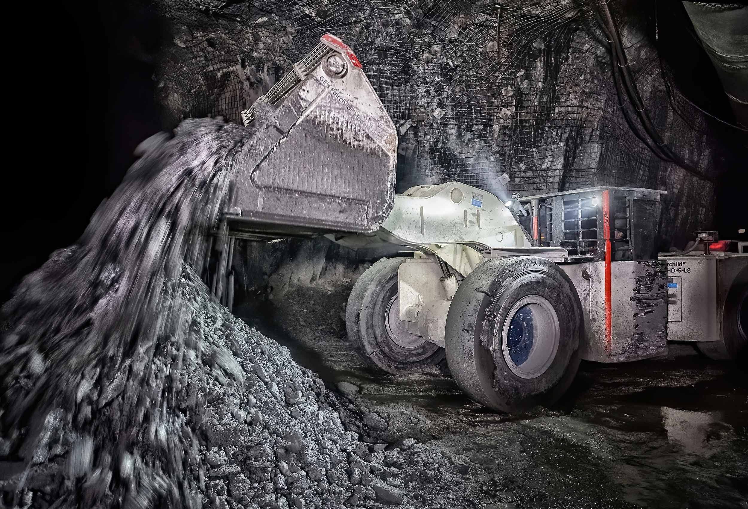 a-pick-up-mining-loader-truck-moves-rocks-during-hard-rock-mining-at-an-iamgold-mine-in-rouyn-noranda-quebec-canada