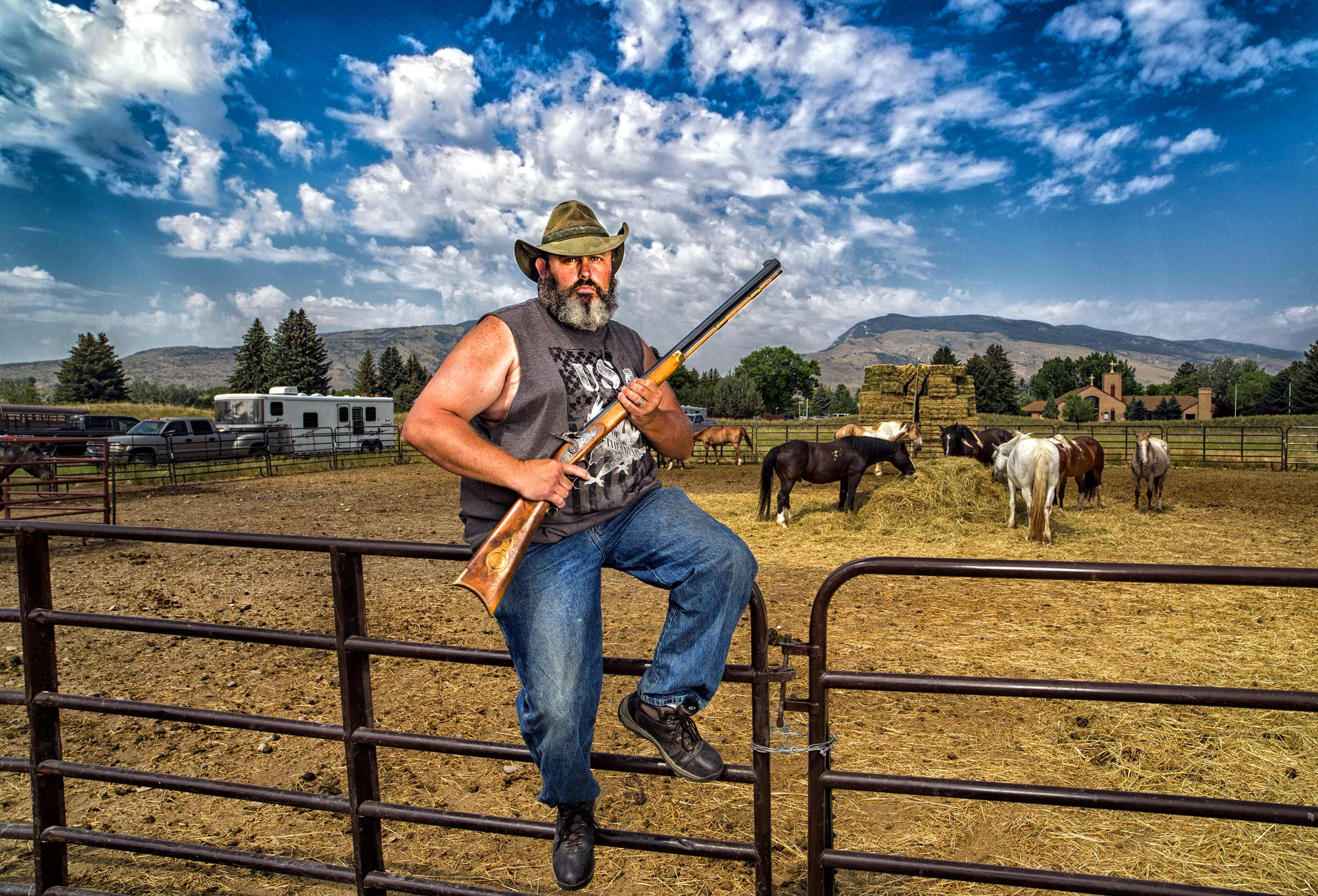 a-portrait-of-a-modern-day-cowboy-and-his-gun-in-cody-wyoming