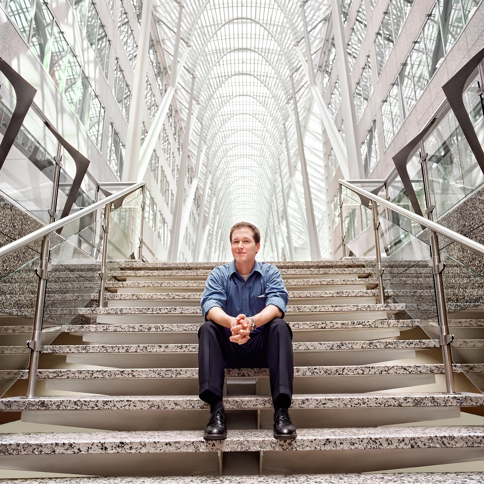 a-rotman-mba-student-poses-for-a-portrait-at-torontos-bce-place