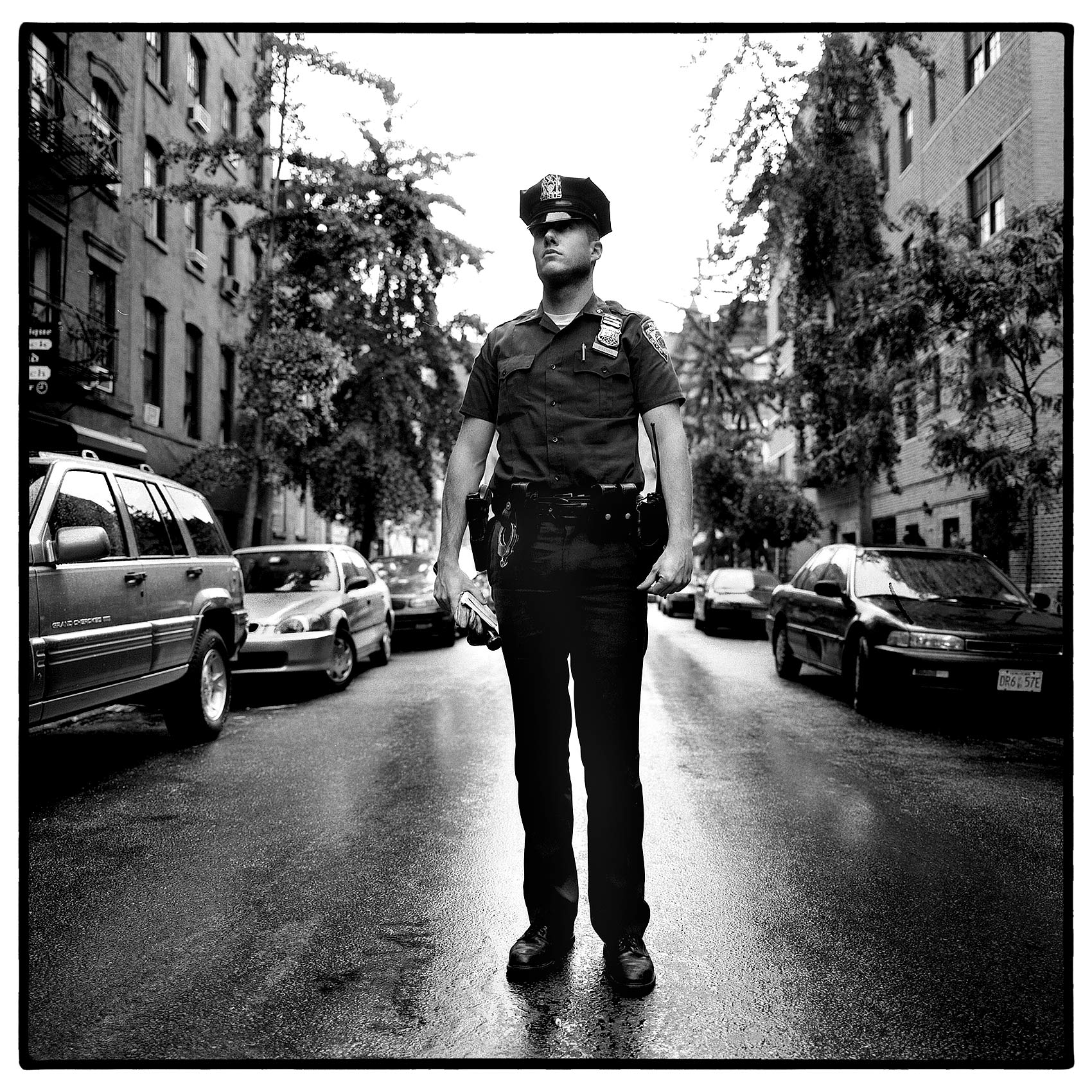 a-sixth-precinct-nypd-officer-poses-for-a-photo-in-new-yorks-greenwich-village