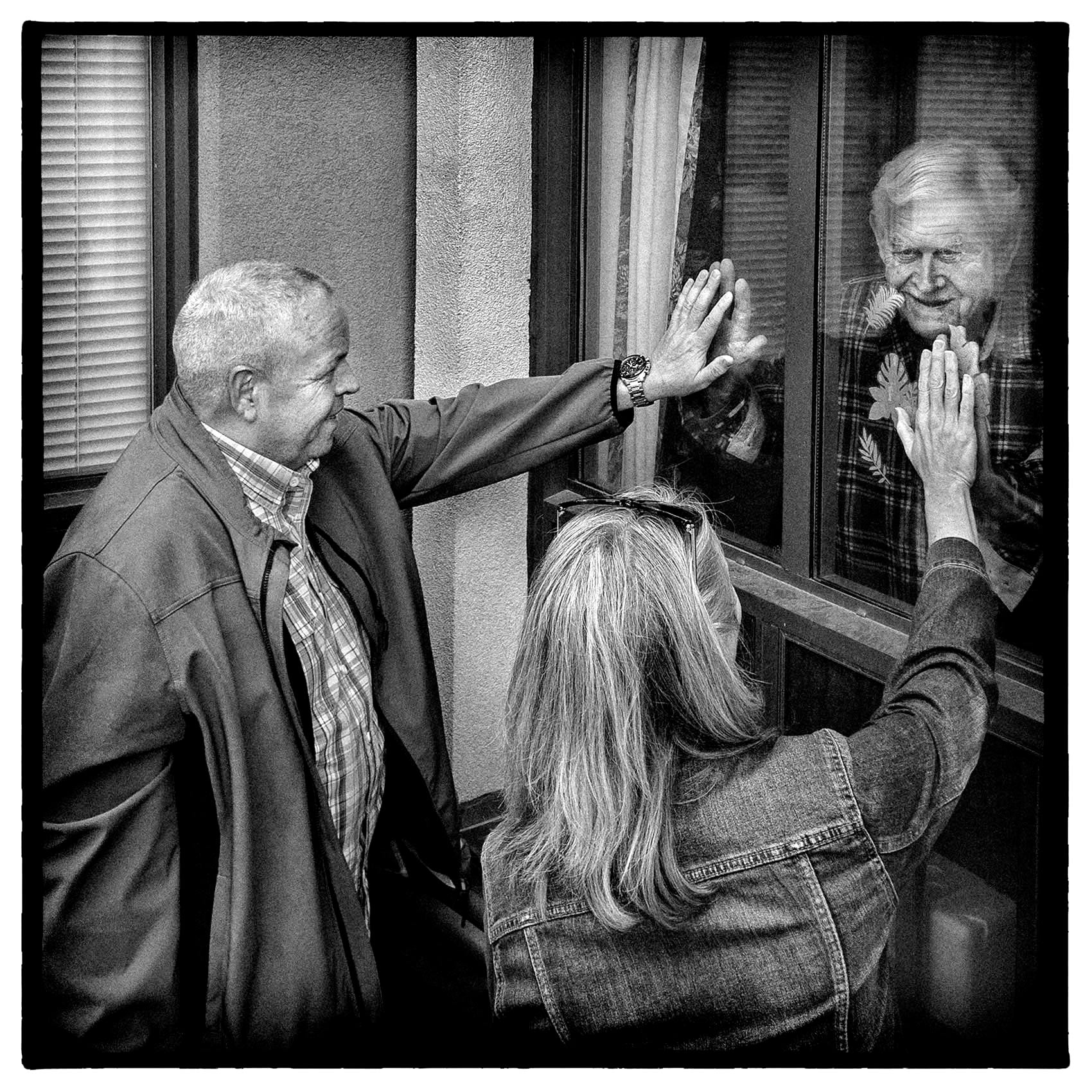 a-son-says-goodbye-to-his-father-through-a-nursing-home-window-during-pandemic