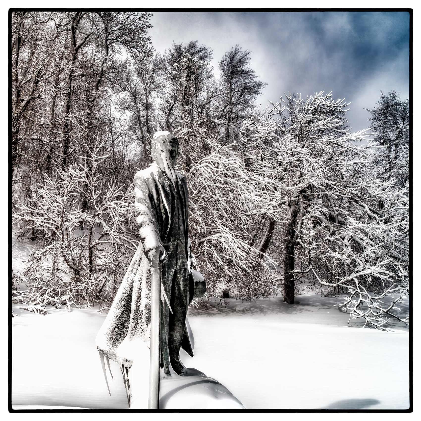 a-statue-of-nikola-tesla-is-covered-in-ice-after-a-storm-in-niagara-falls-ontario