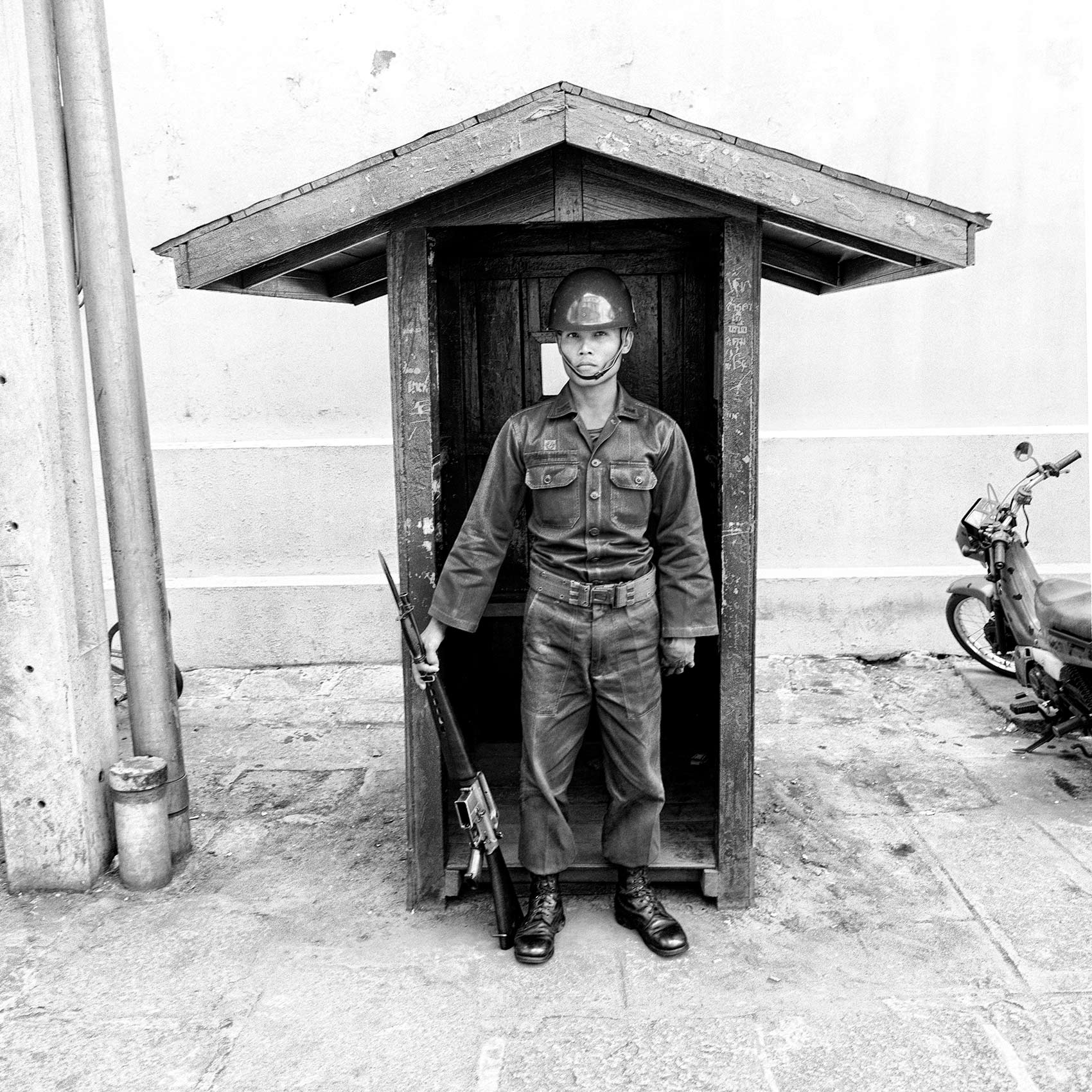 a-thai-soldier-stands-on-guard-outside-the-royal-palace-in-bangkok-thailand