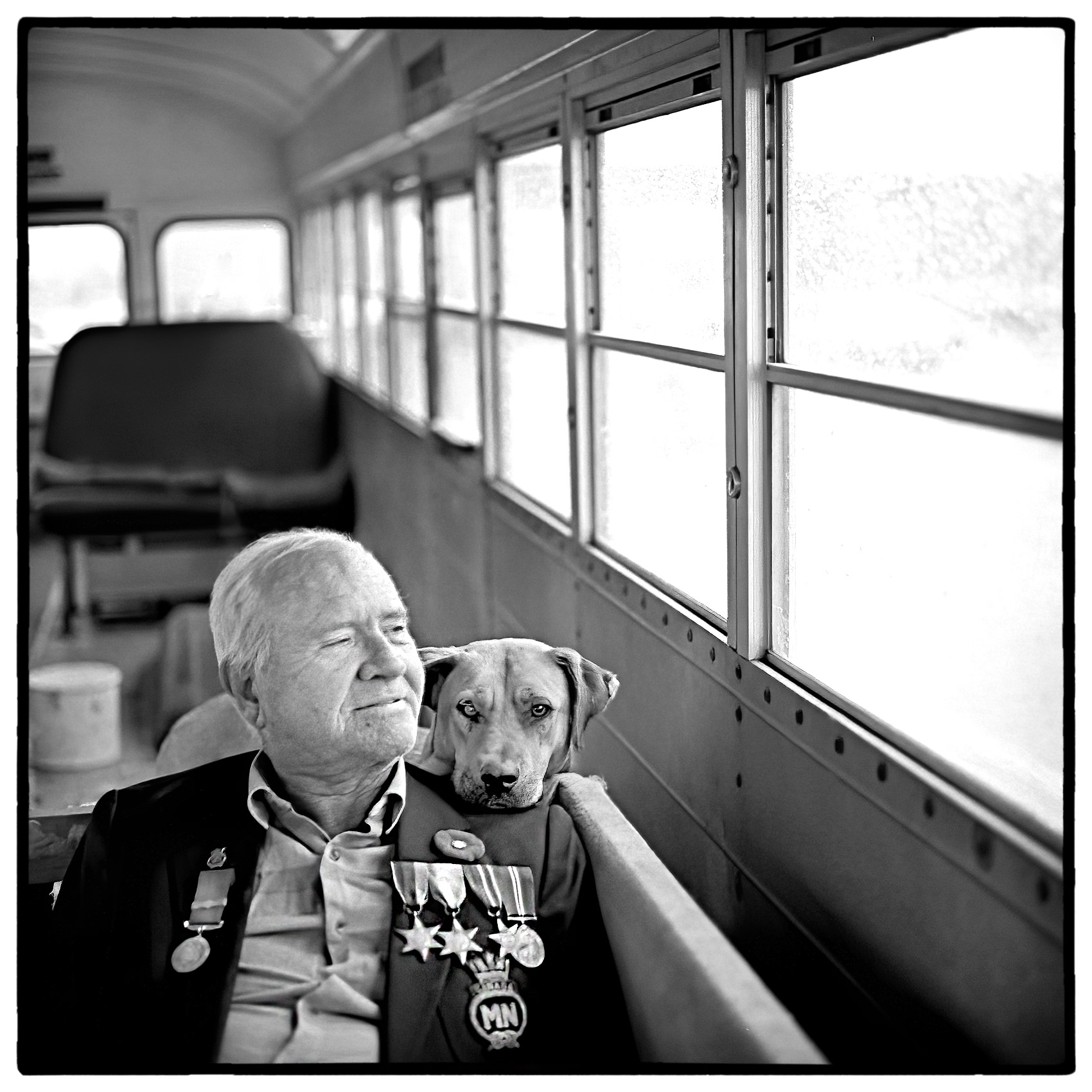 a-war-veteran-and-his-dog-who-live-in-a-school-bus-in-ottawa