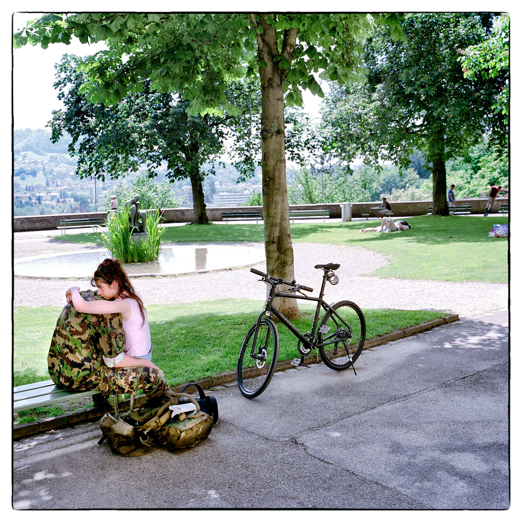a-woman-hugs-her-boyfriend-before-he-leaves-for-duty-at-a-park-in-geneva-switzerland