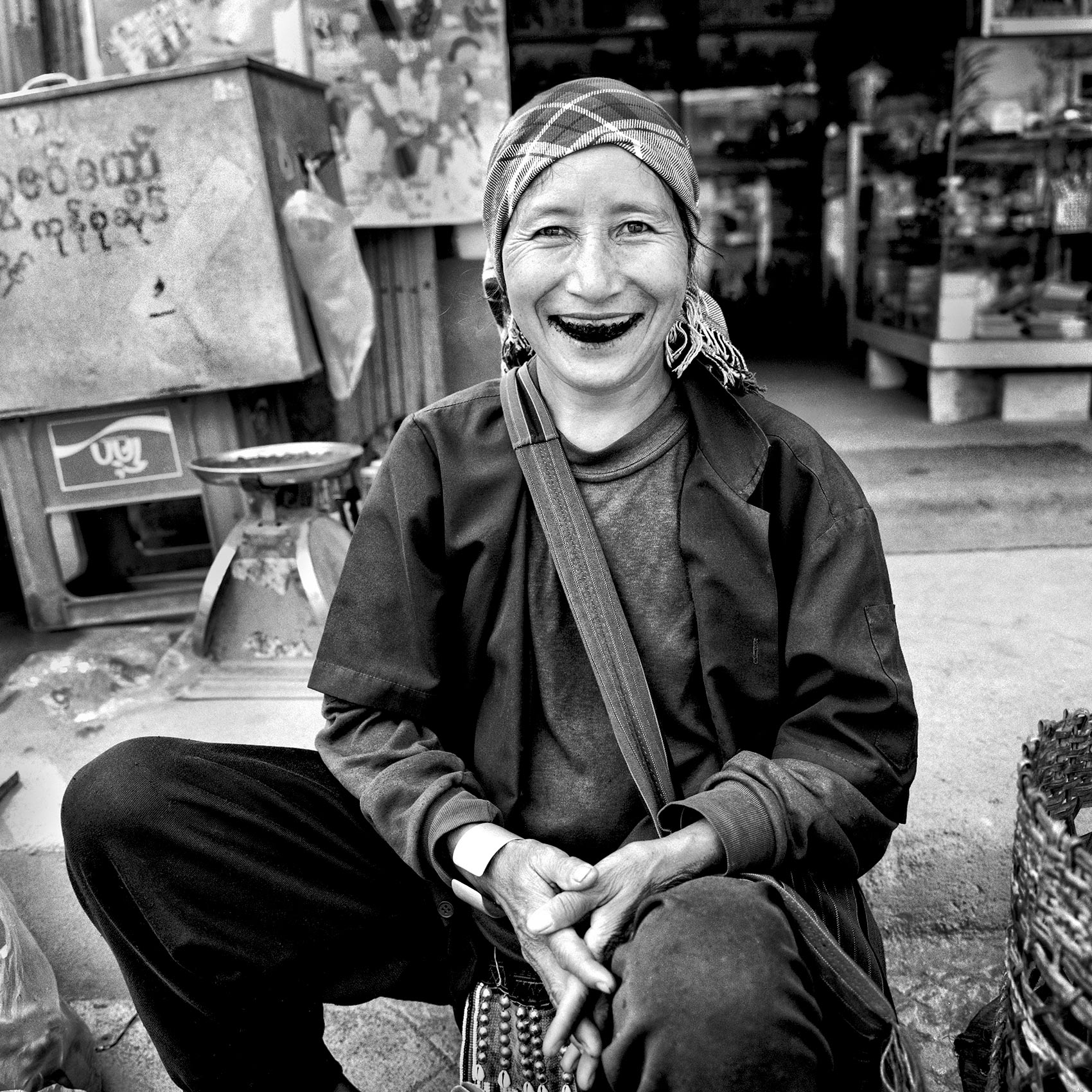 a-woman-in-an-myanmar-village-smiles-showing-her-dark-teeth-stained-by-betel-nut-chew-which-is-made-of-the-nut-and-tobacco