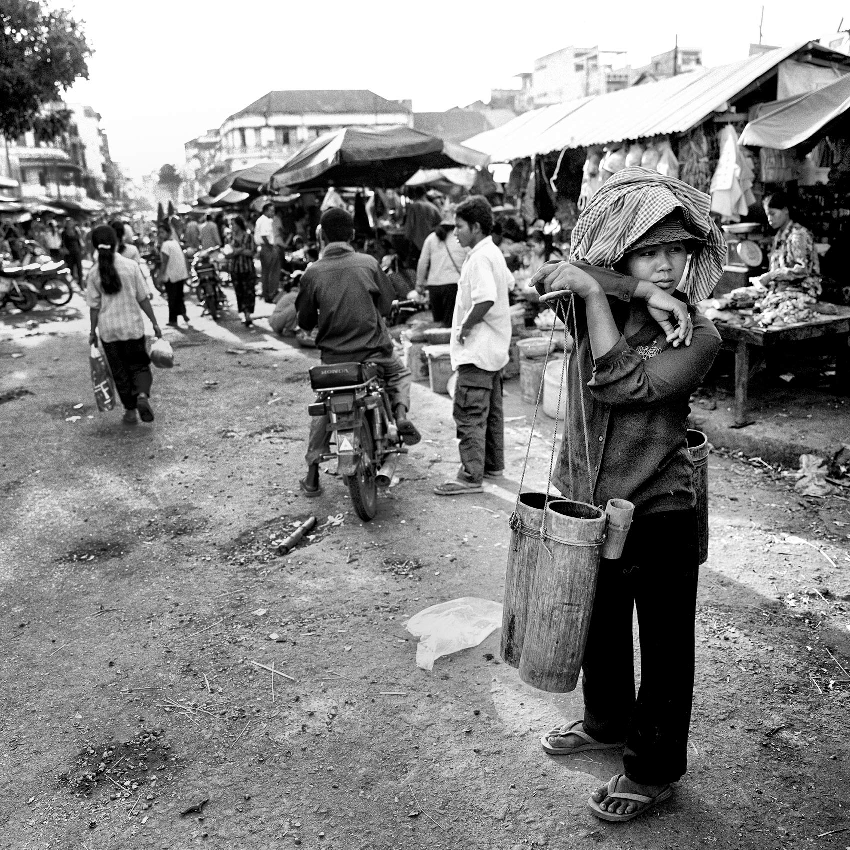 a-woman-in-an-outdoor-market-takes-a-break-from-selling-water-in-phnom-penh-cambodia