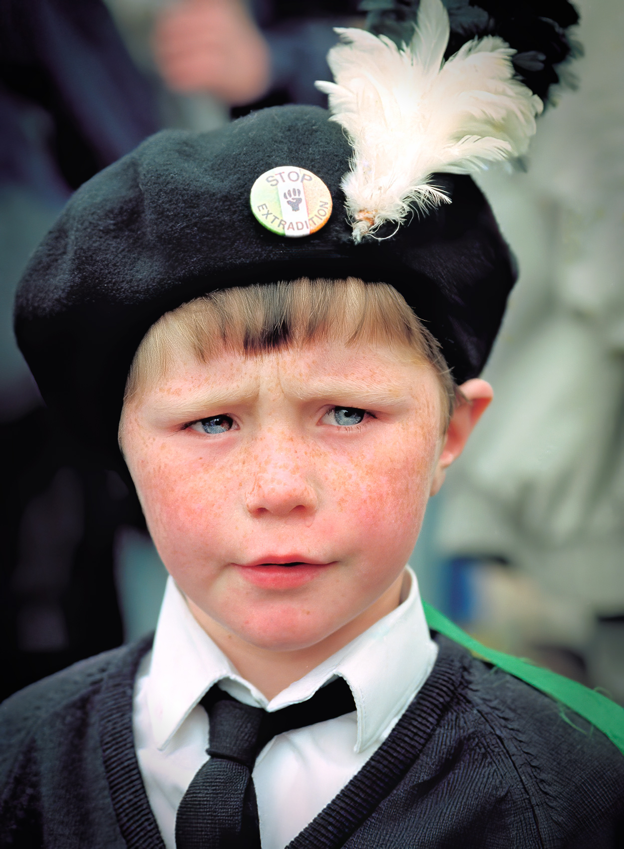 a-young-boy-wears-a-beret-with-a-white-feather-duringa-march-in-catholic-west-belfast-northern-ireland