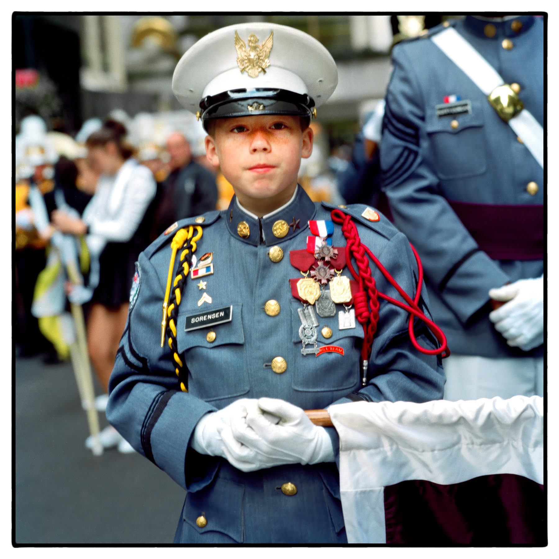 a-young-decorated-military-school-cadet-shows-off-his-medals-at-new-yorks-thanksgiving-day-parade