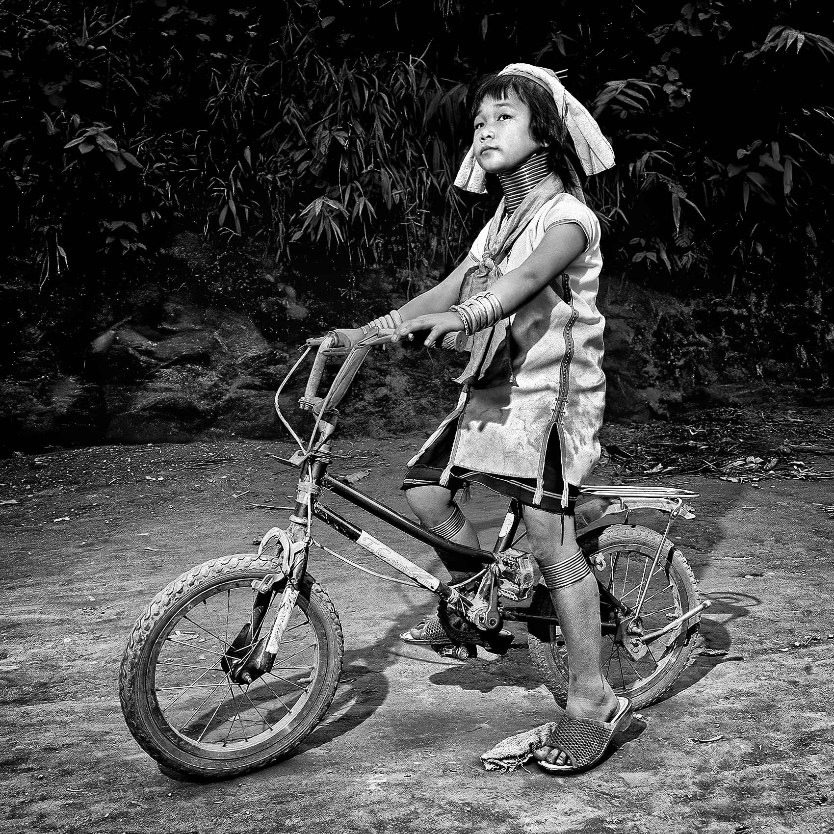 a-young-girl-from-the-karen-tribe-on-her-bicycle-in-northern-thailand