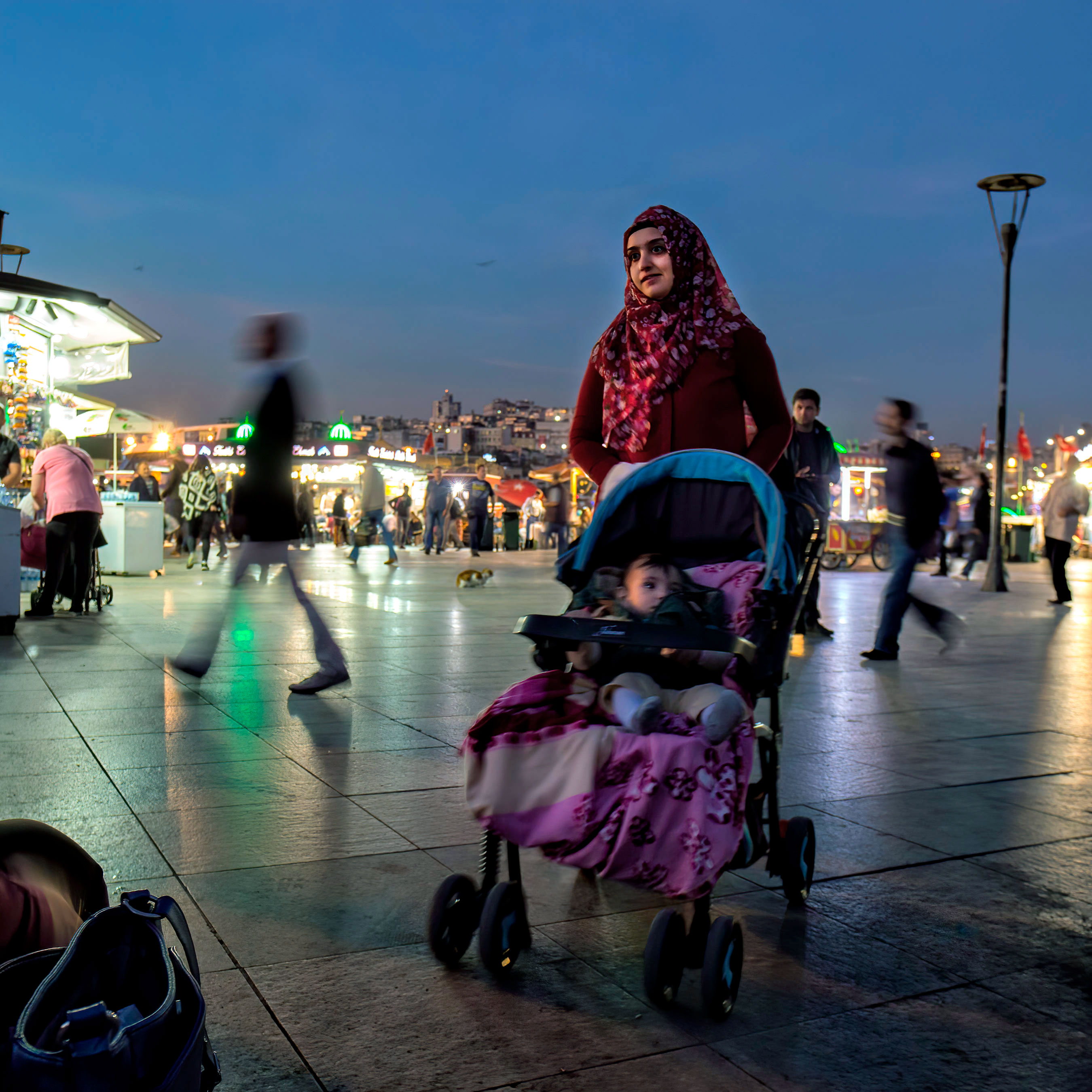 a-young-woman-and-her-baby-in-istanbuls-eminonu-bazaar