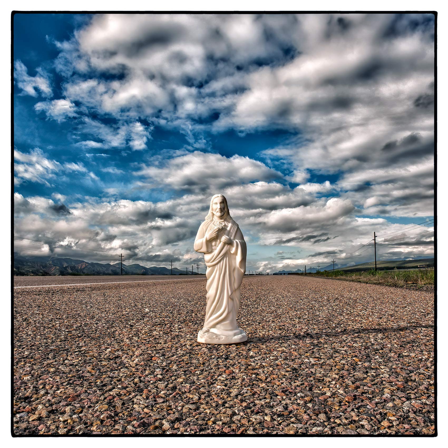 an-abandoned-statue-of-jesus-stands-by-the-side-of-a-highway-in-rural-nevada-usa