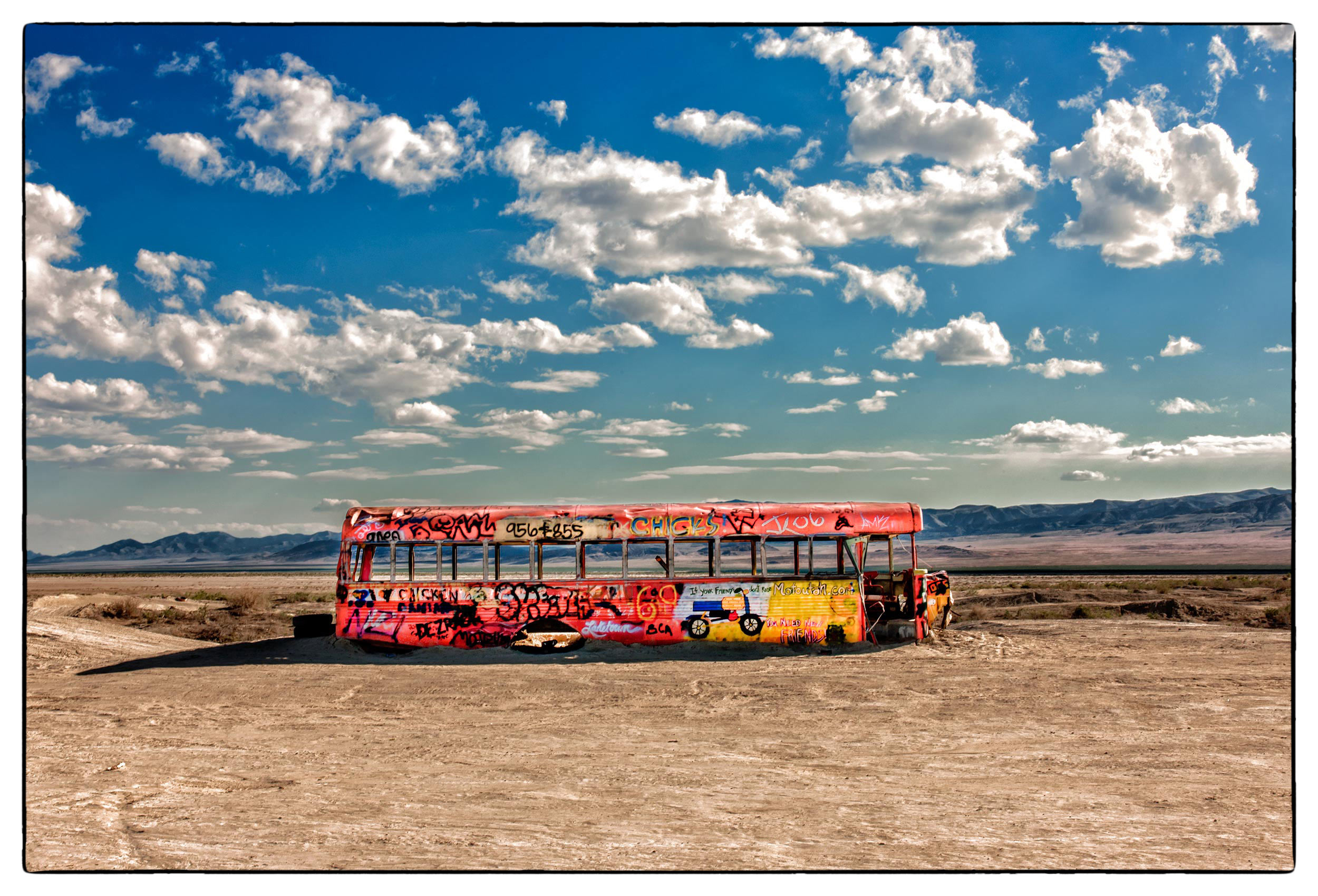 an-abandoned-yellow-school-bus-sits-in-the-middle-of-the-nevada-desert-outside-a-military-bombing-range