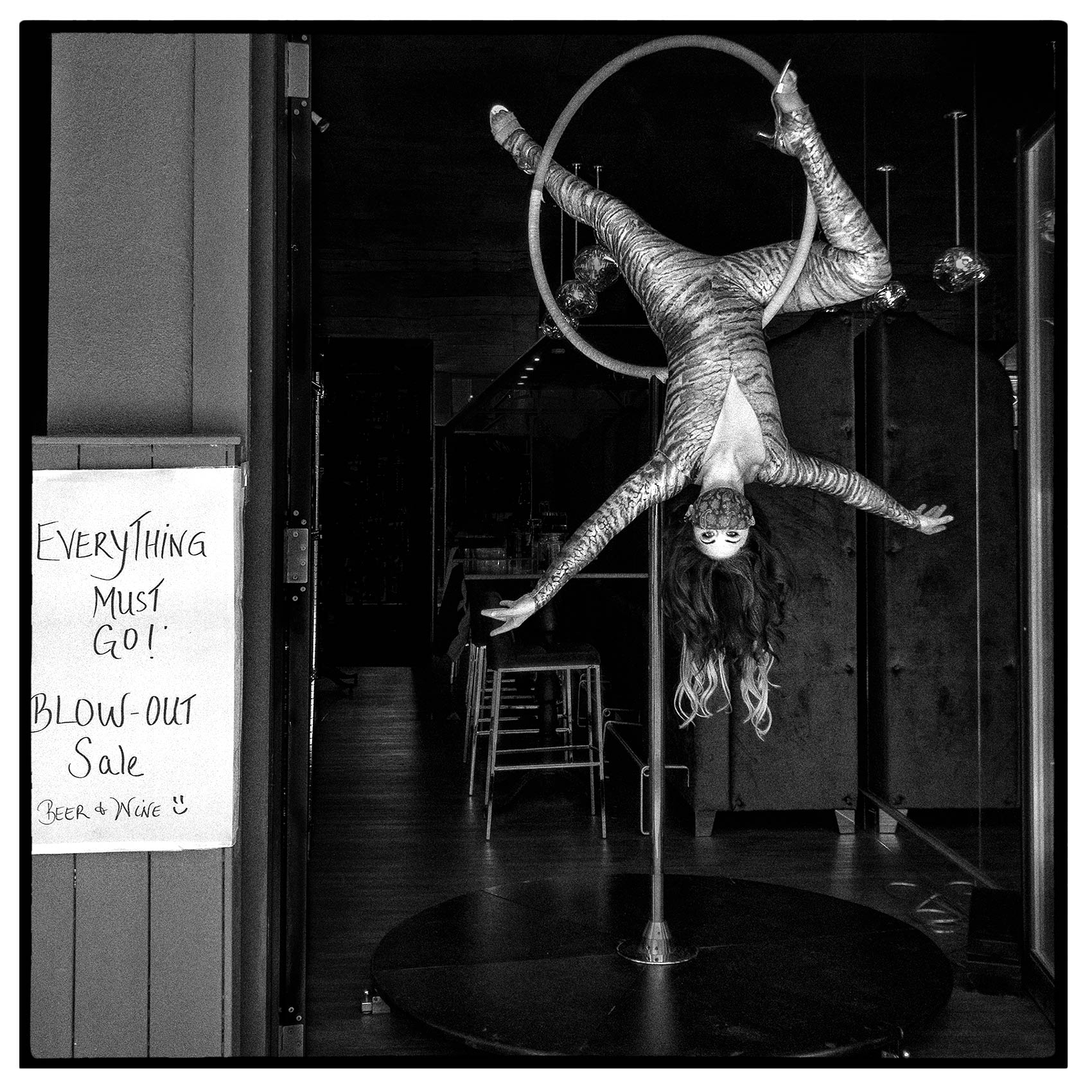 a restaurant sells off its alcohol during the pandemic by using an acrobat during covid-19