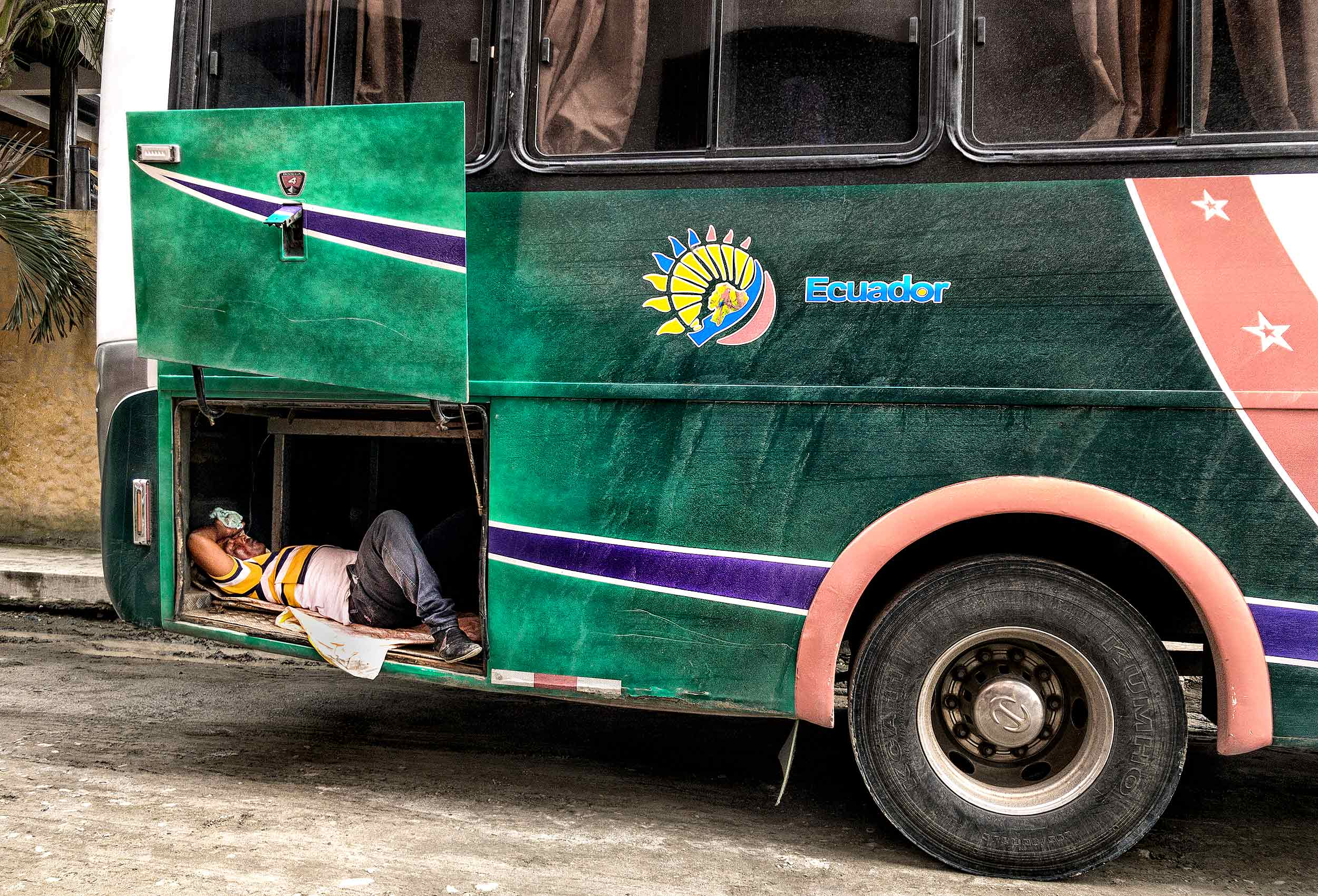 an-ecuadorian-bus-driver-sleeps-in-the-back-of-his-bus-compartment