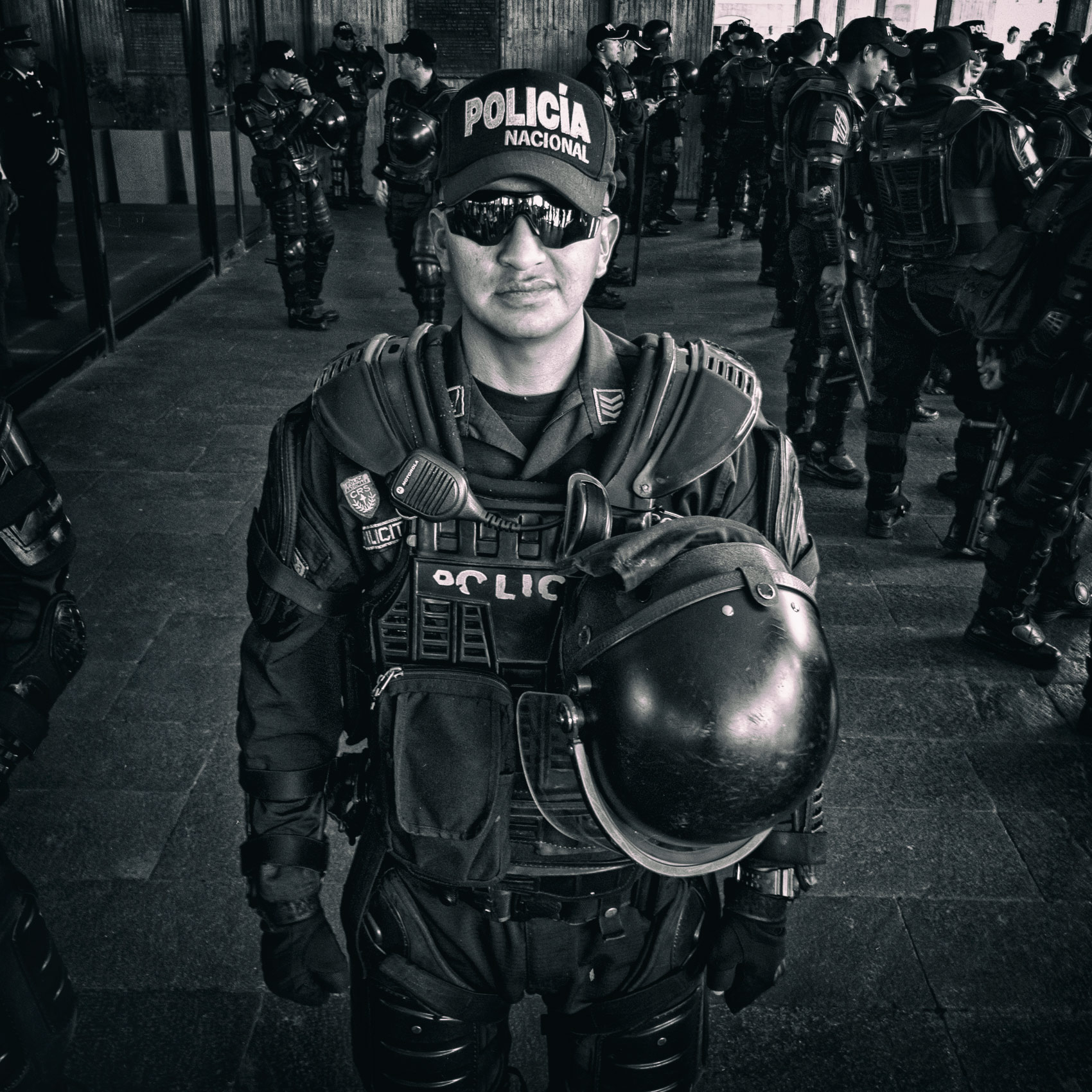 an-ecuadorian-riot-police-officer-poses-for-a-photo-during-a-protest-in-quito