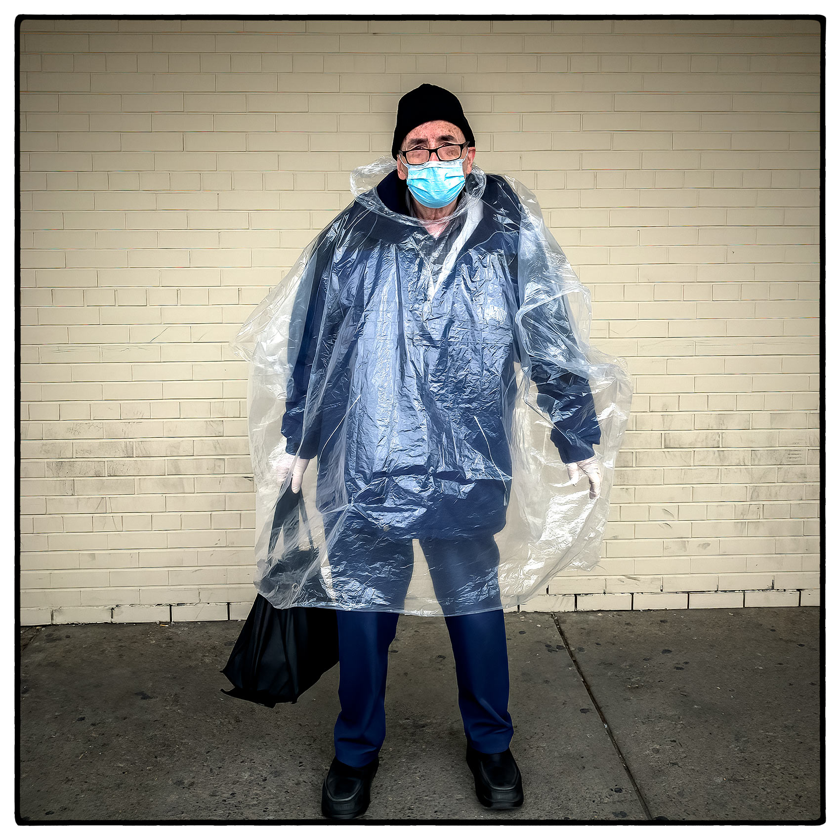 an-elderly-shopper-wears-a-plastic-bag-for-protection-from-covid-19
